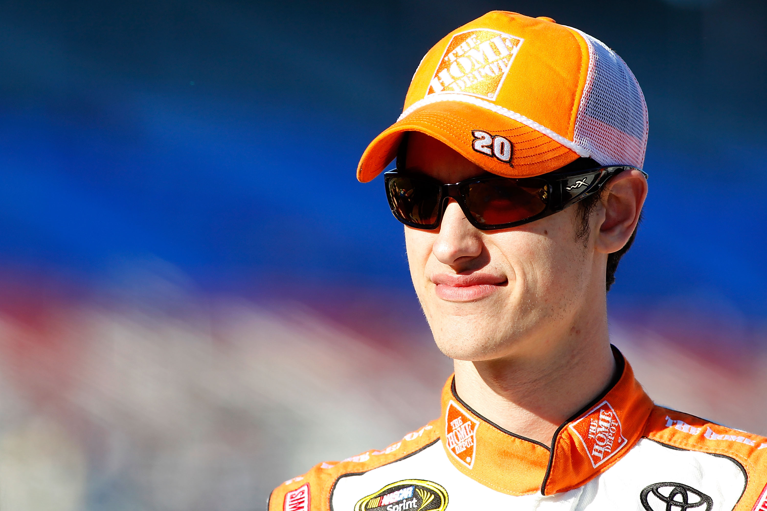 FORT WORTH, TX - NOVEMBER 05:  Joey Logano, driver of the #20 Home Depot Toyota, stands on the grid during qualifying for the NASCAR Sprint Cup Series AAA Texas 500 at Texas Motor Speedway on November 5, 2010 in Fort Worth, Texas.  (Photo by Todd Warshaw/