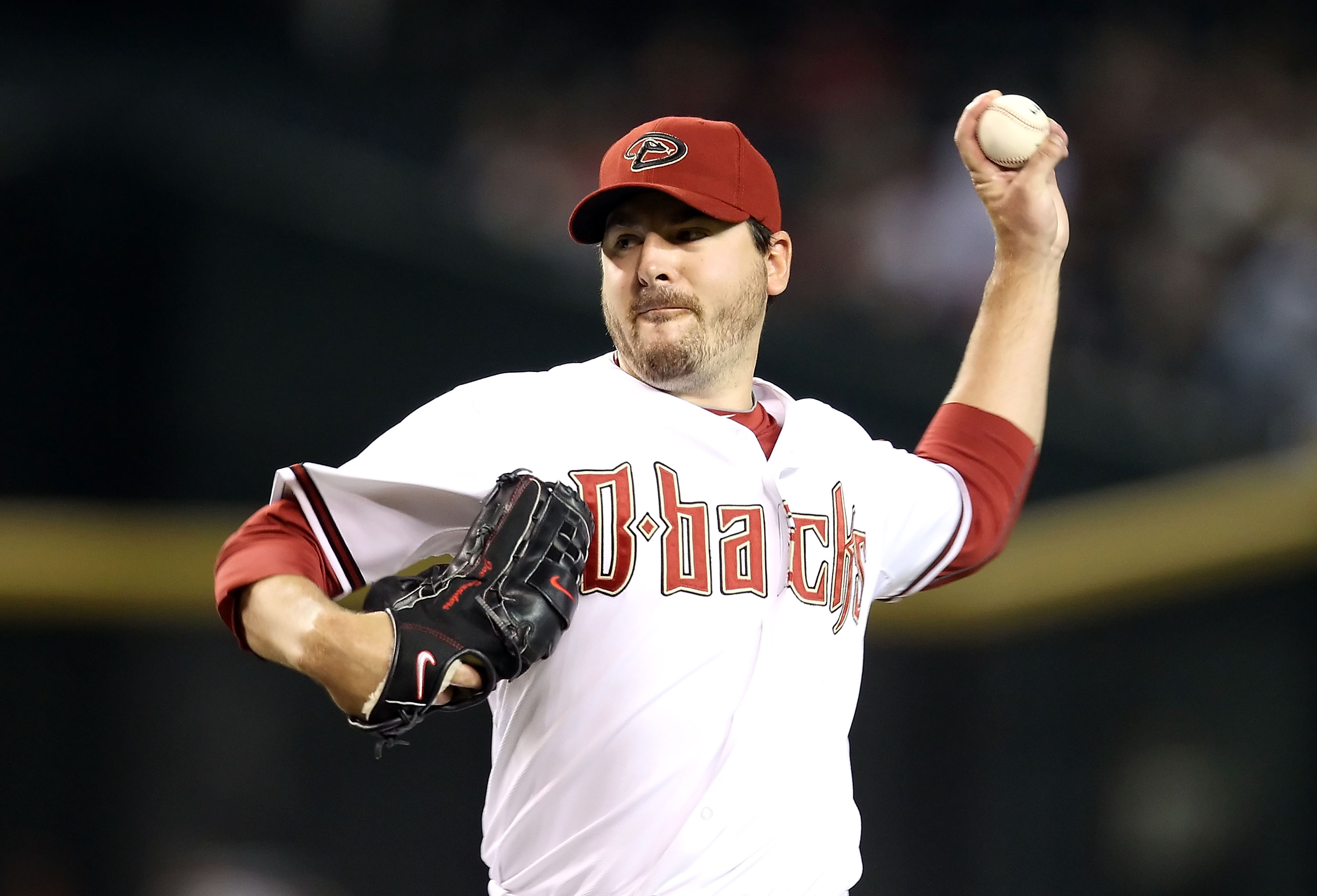 PHOENIX - SEPTEMBER 21:  Starting pitcher Joe Saunders #34 of the Arizona Diamondbacks pitches against the Colorado Rockies during the Major League Baseball game at Chase Field on September 21, 2010 in Phoenix, Arizona.  (Photo by Christian Petersen/Getty