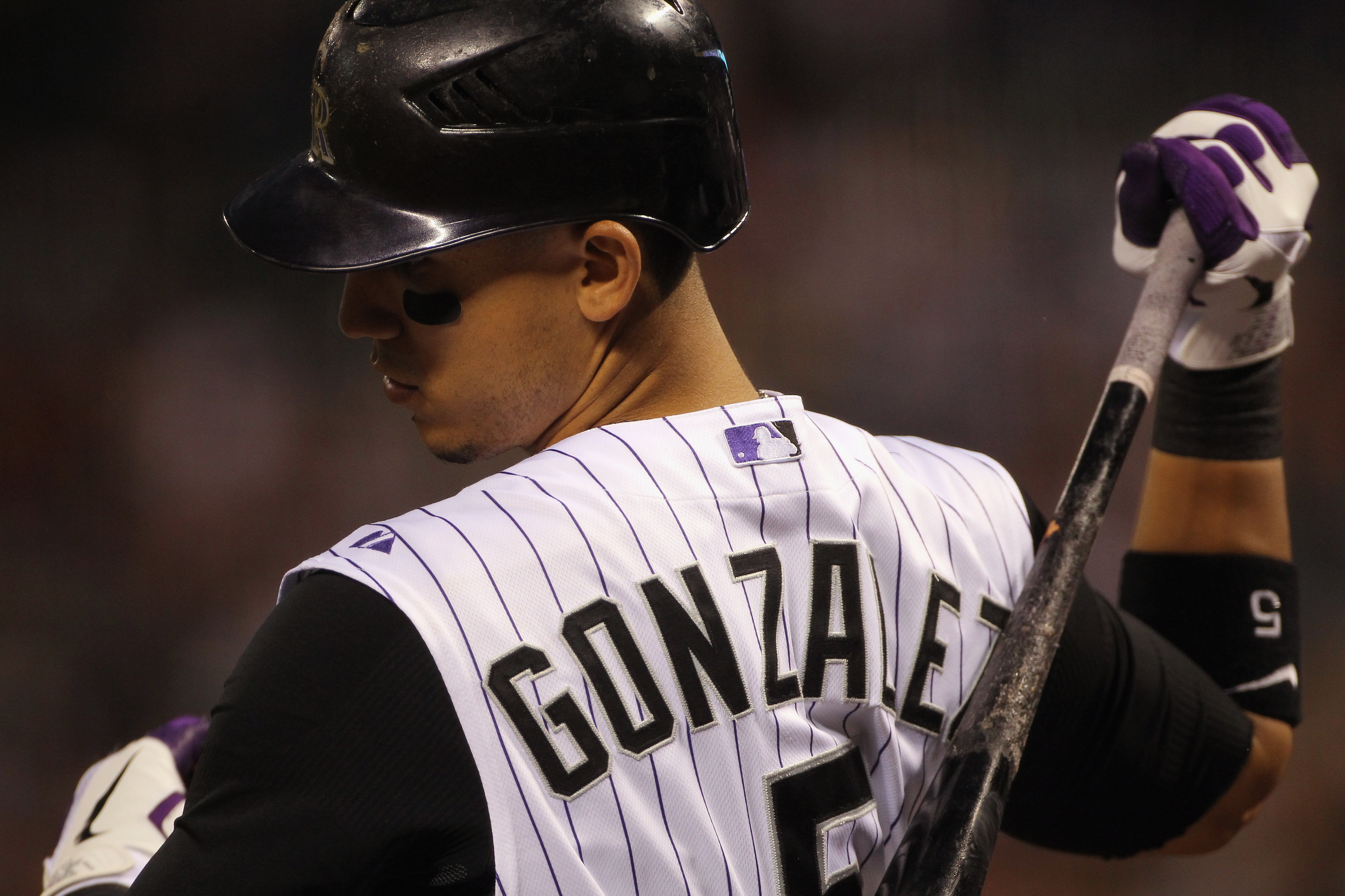 DENVER - SEPTEMBER 27:  Carlos Gonzalez #5 of the Colorado Rockies warms up on deck as he prepares to take an at bat against the Los Angeles Dodgers at Coors Field on September 25, 2010 in Denver, Colorado. The Dodgers defeated the Rockies 3-1.  (Photo by