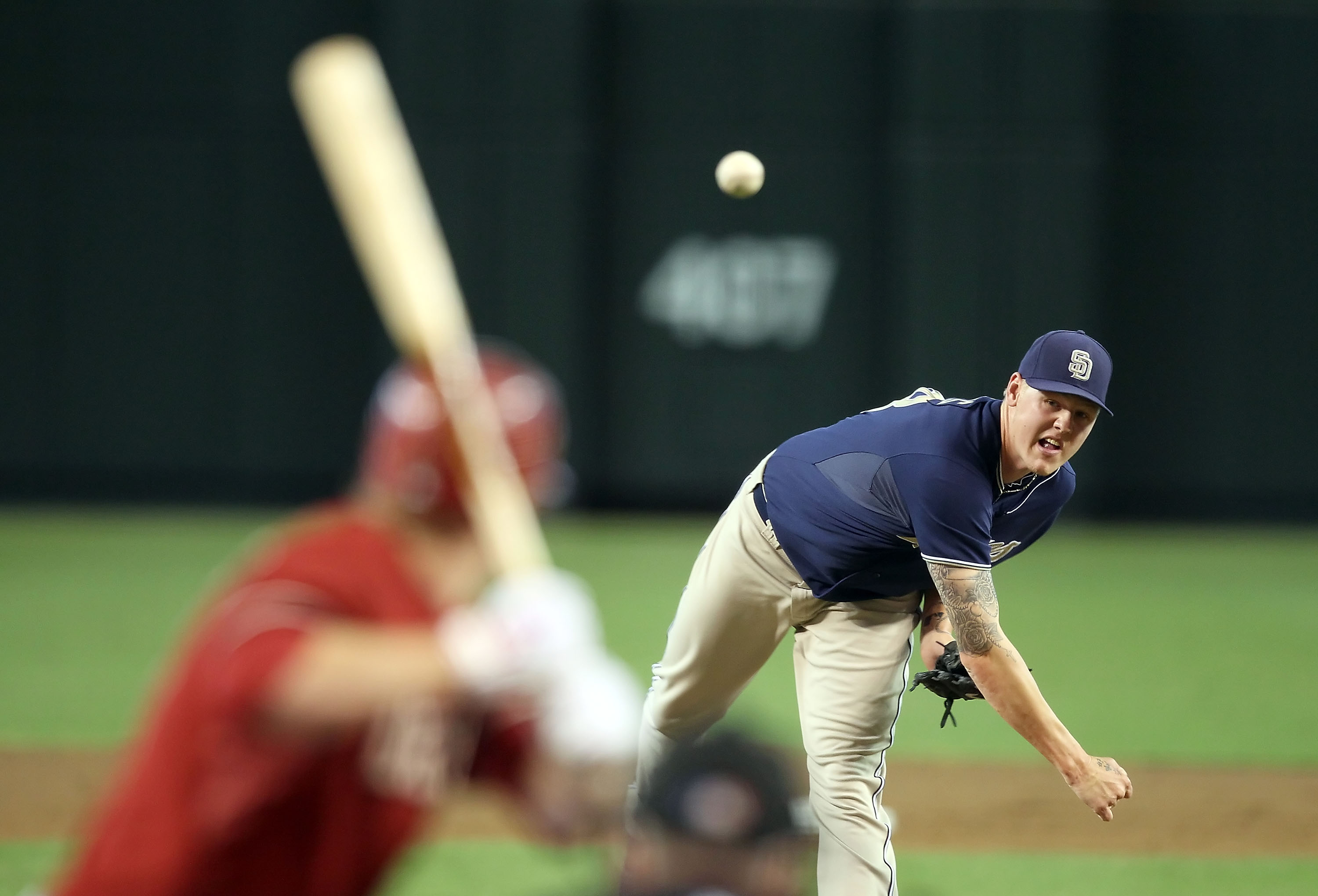 PHOENIX - SEPTEMBER 01:  Starting pitcher Mat Latos #38 of the San Diego Padres pitches against the Arizona Diamondbacks during the Major League Baseball game at Chase Field on September 1, 2010 in Phoenix, Arizona. The Diamondbacks defeated the Padres 5-
