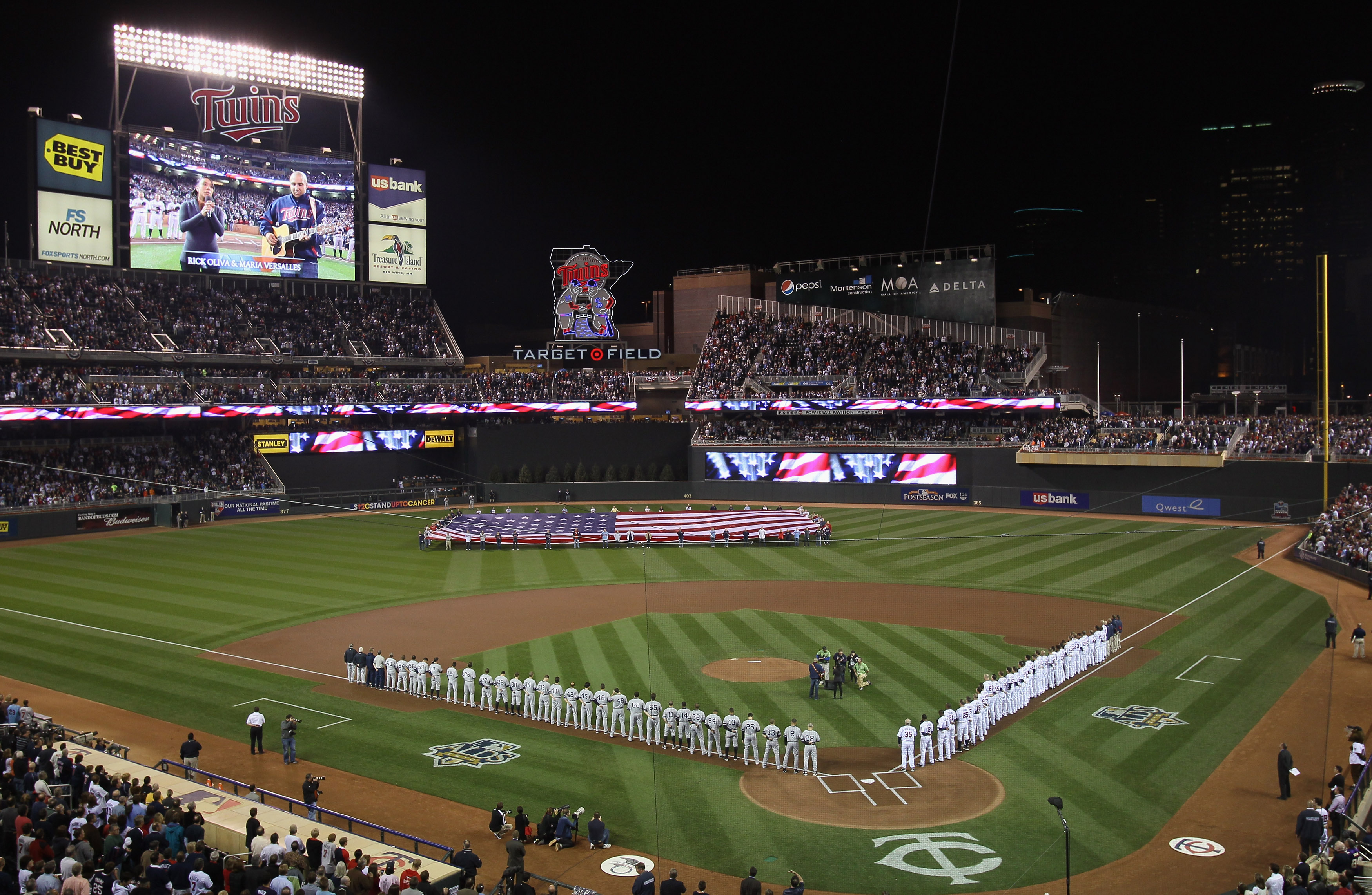 MINNEAPOLIS - OCTOBER 06:  The Minnesota Twins  and the New York Yankees line up before game one of the ALDS on October 6, 2010 at Target Field in Minneapolis, Minnesota.  (Photo by Elsa/Getty Images)