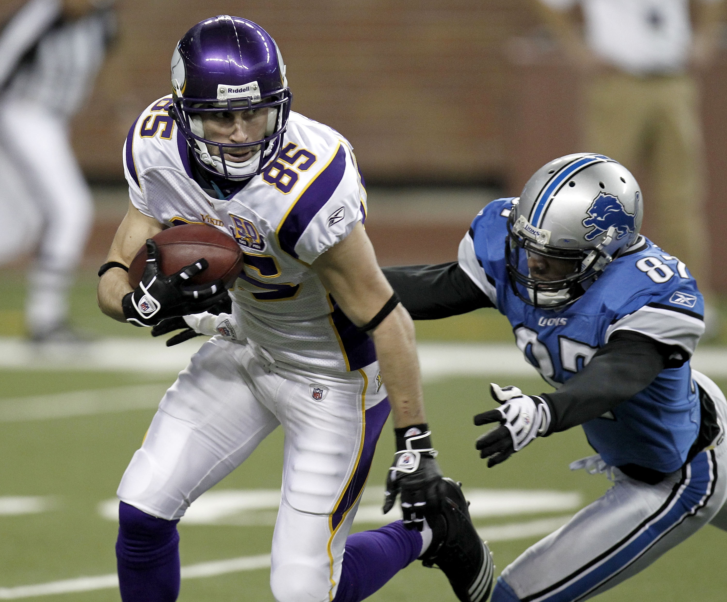 DETROIT, MI - JANUARY 02: Greg Camarillo #85 of the Minnesota Vikings is chased by Brian Clark #87 of the Detroit Lions while he retuns a fourth quarter punt at Ford Field on January 2, 2011 in Detroit, Michigan.  (Photo by Gregory Shamus/Getty Images)