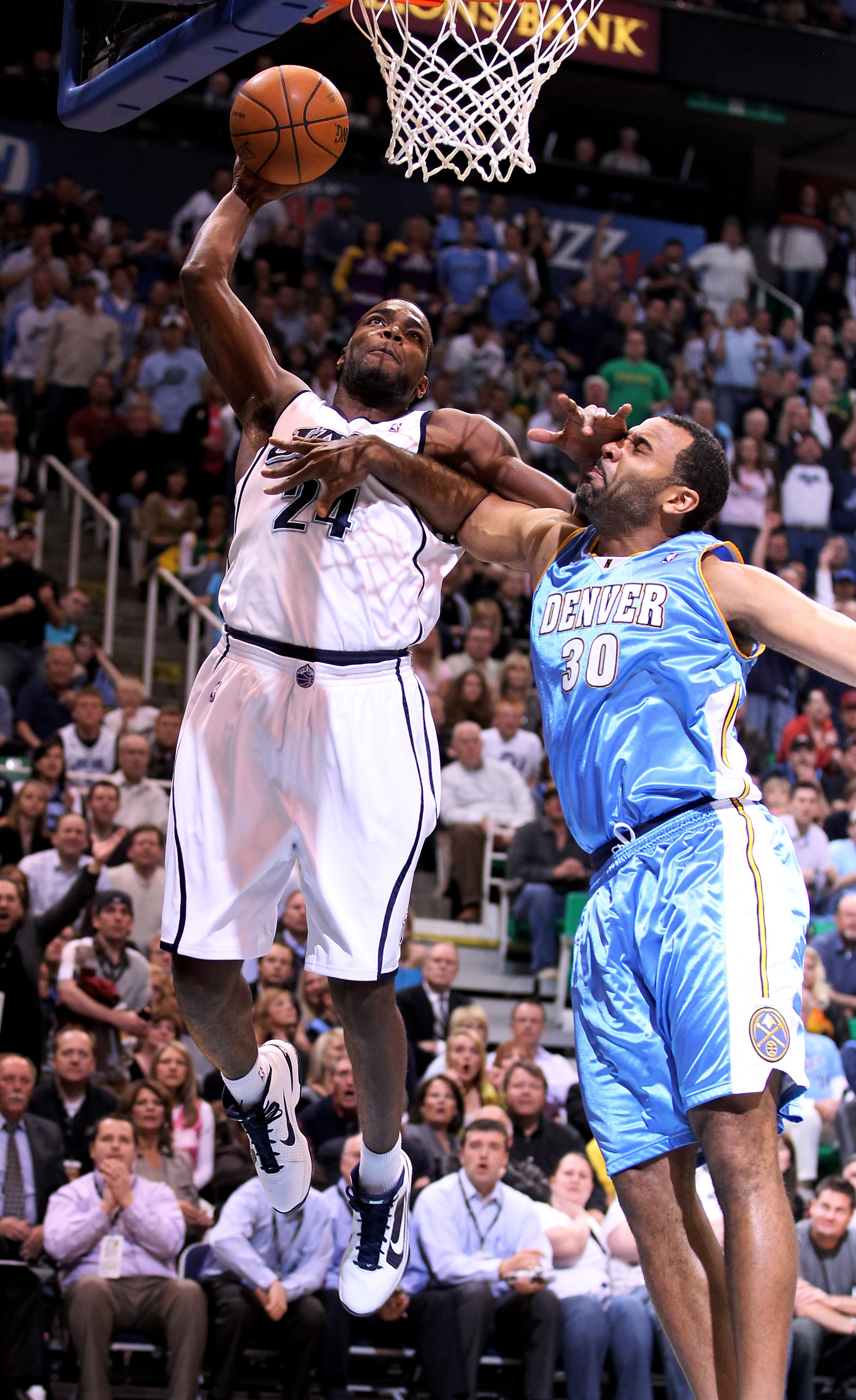 SALT LAKE CITY - APRIL 30:  Paul Millsap #24 of the Utah Jazz dunks over Malik Allen #30 of the Denver Nuggets during Game Six of the Western Conference Quarterfinals of the 2010 NBA Playoffs at EnergySolutions Arena on April 30, 2010 in Salt Lake City, U