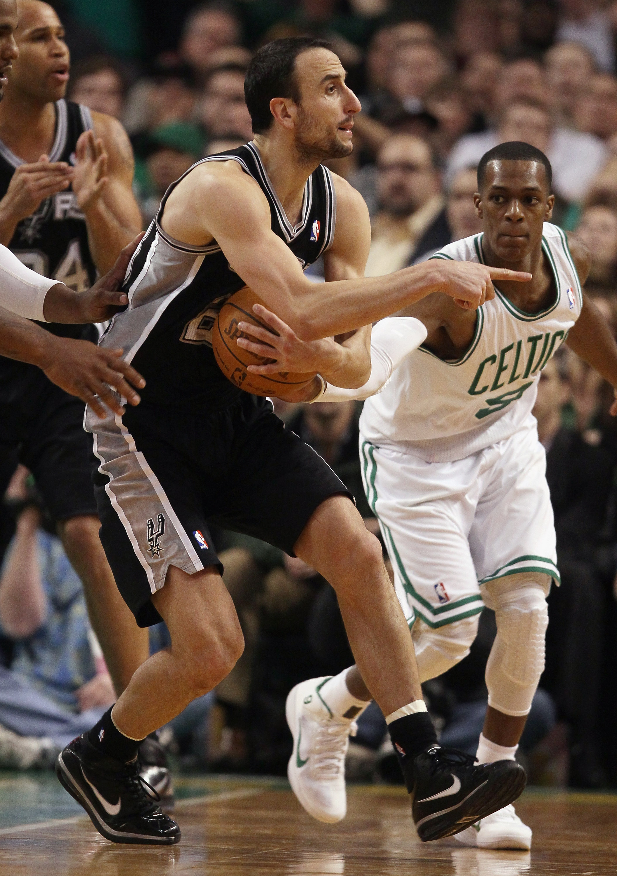 BOSTON, MA - JANUARY 05:  Manu Ginobili #20 of the San Antonio Spurs tries to keep the ball as Rajon Rondo #9 of the Boston Celtics defends on January 5, 2011 at the TD Garden in Boston, Massachusetts. The Celtics defeated the Spurs 105-103. NOTE TO USER:
