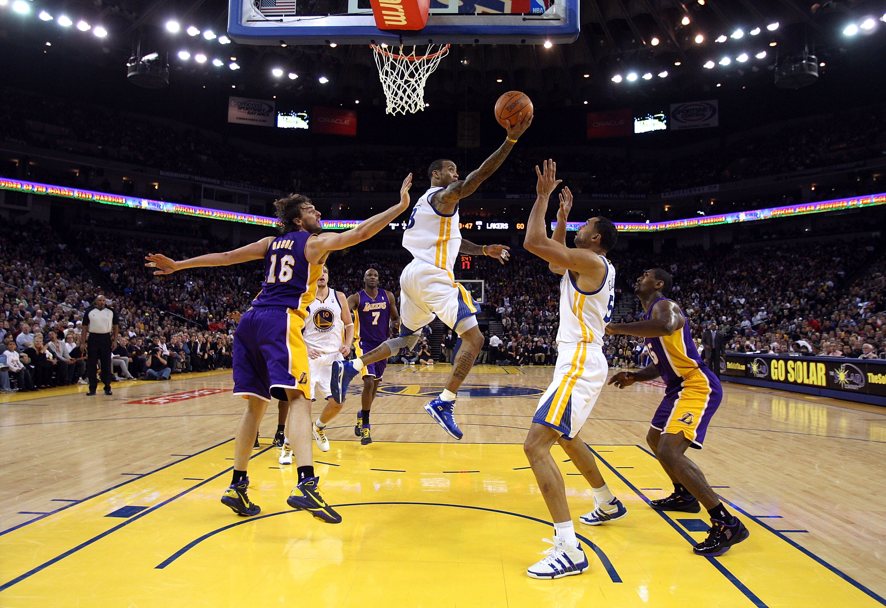 OAKLAND, CA - JANUARY 12:  Monta Ellis #8 of the Golden State Warriors goes up for a shot against the Los Angeles Lakers at Oracle Arena on January 12, 2011 in Oakland, California. NOTE TO USER: User expressly acknowledges and agrees that, by downloading