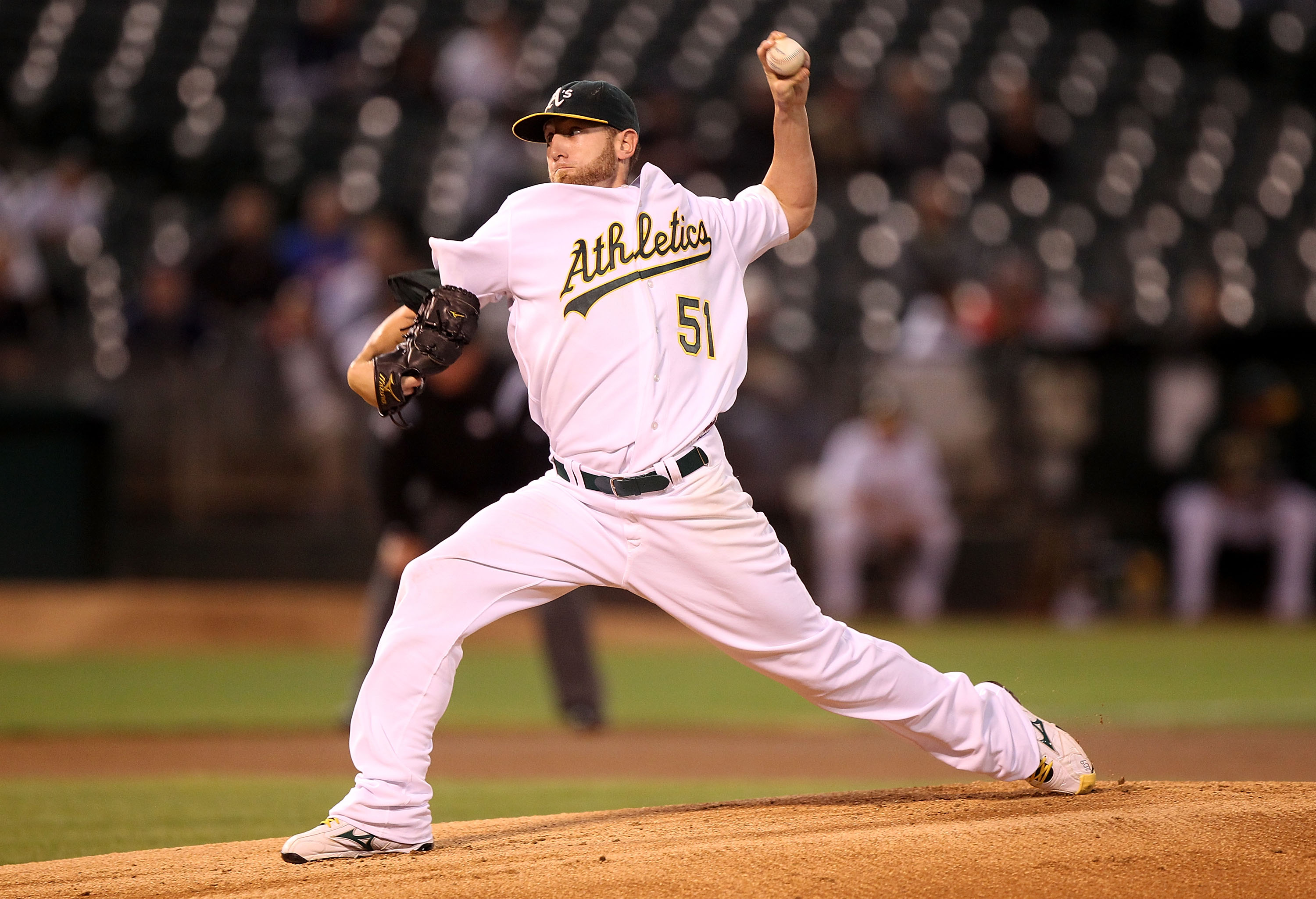 OAKLAND, CA - SEPTEMBER 23:  Dallas Braden #51 of the Oakland Athletics pitches against the Texas Rangers during a Major League Baseball game at the Oakland-Alameda County Coliseum on September 23, 2010 in Oakland, California. (Photo by Jed Jacobsohn/Gett