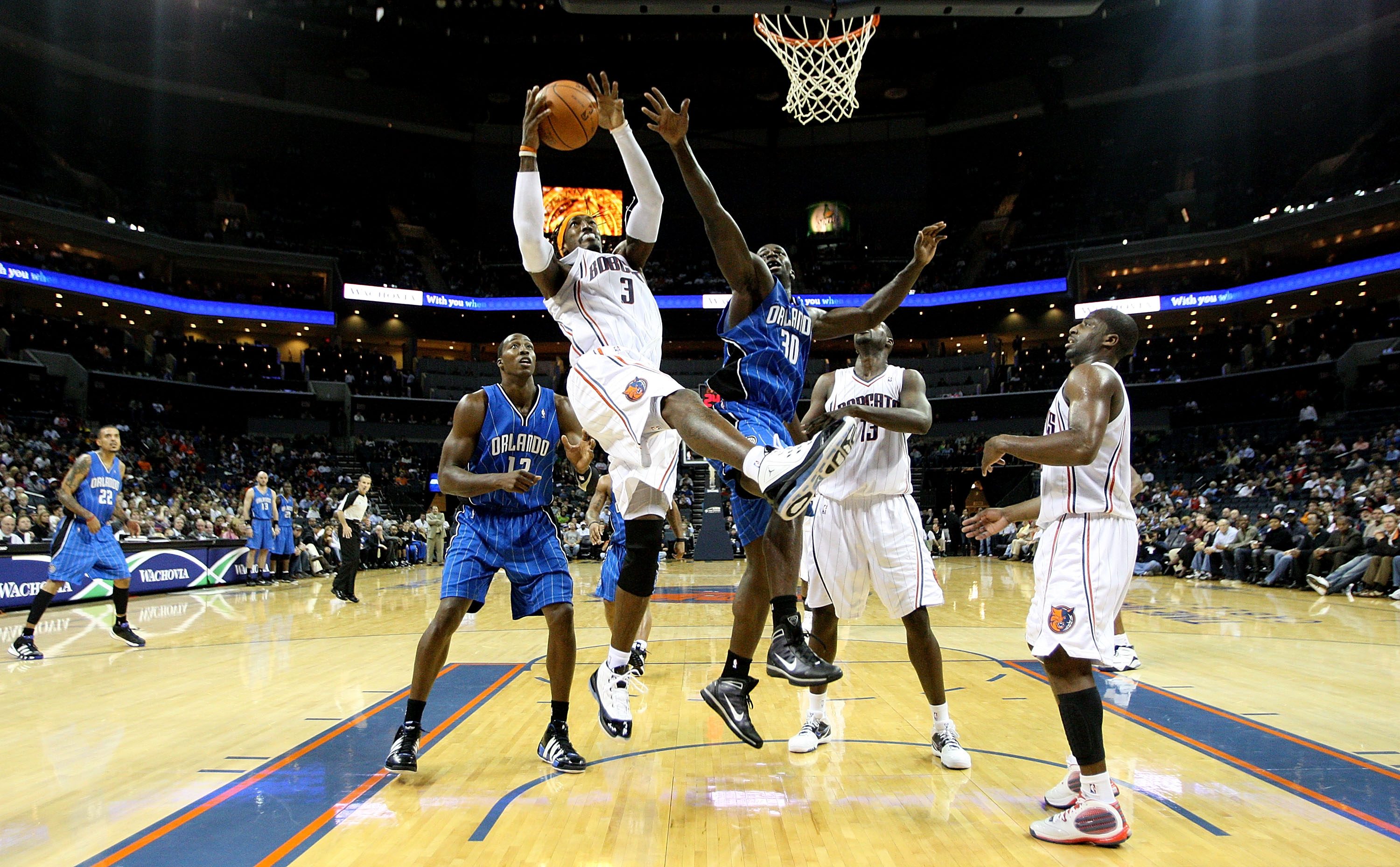 CHARLOTTE, NC - NOVEMBER 10:  Brandon Bass #30 of the Orlando Magic goes up for a rebound against Gerald Wallace #3 of the Charlotte Bobcats in NBA action at Time Warner Cable Arena on November 10, 2009 in Charlotte, North Carolina. NOTE TO USER: User exp