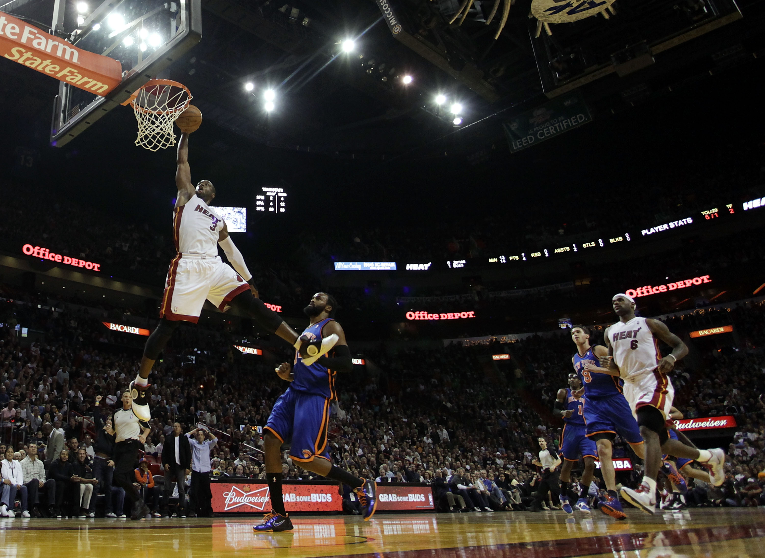 MIAMI - DECEMBER 28:  Guard Dwyane Wade #3 of the Miami Heat dunks against the New York Knicks at American Airlines Arena on December 28, 2010 in Miami, Florida.  (Photo by Marc Serota/Getty Images)