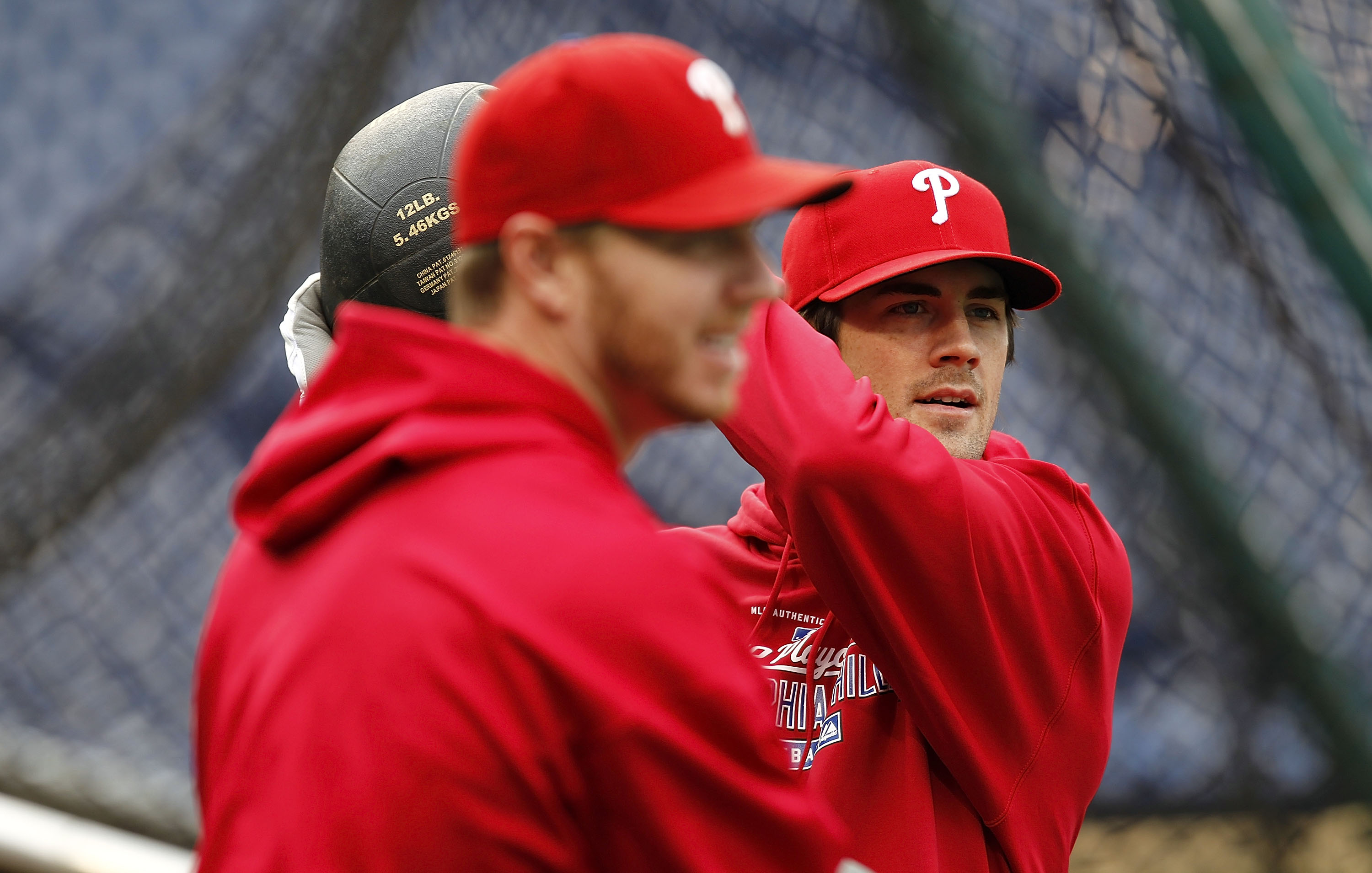 PHILADELPHIA - OCTOBER 15:  Cole Hamels #35 and Roy Halladay #34 of the Philadelphia Phillies stretch during a workout before the NLCS against the San Francisco Giants at Citizens Bank Park on October 15, 2010 in Philadelphia, Pennsylvania.  (Photo by Jef