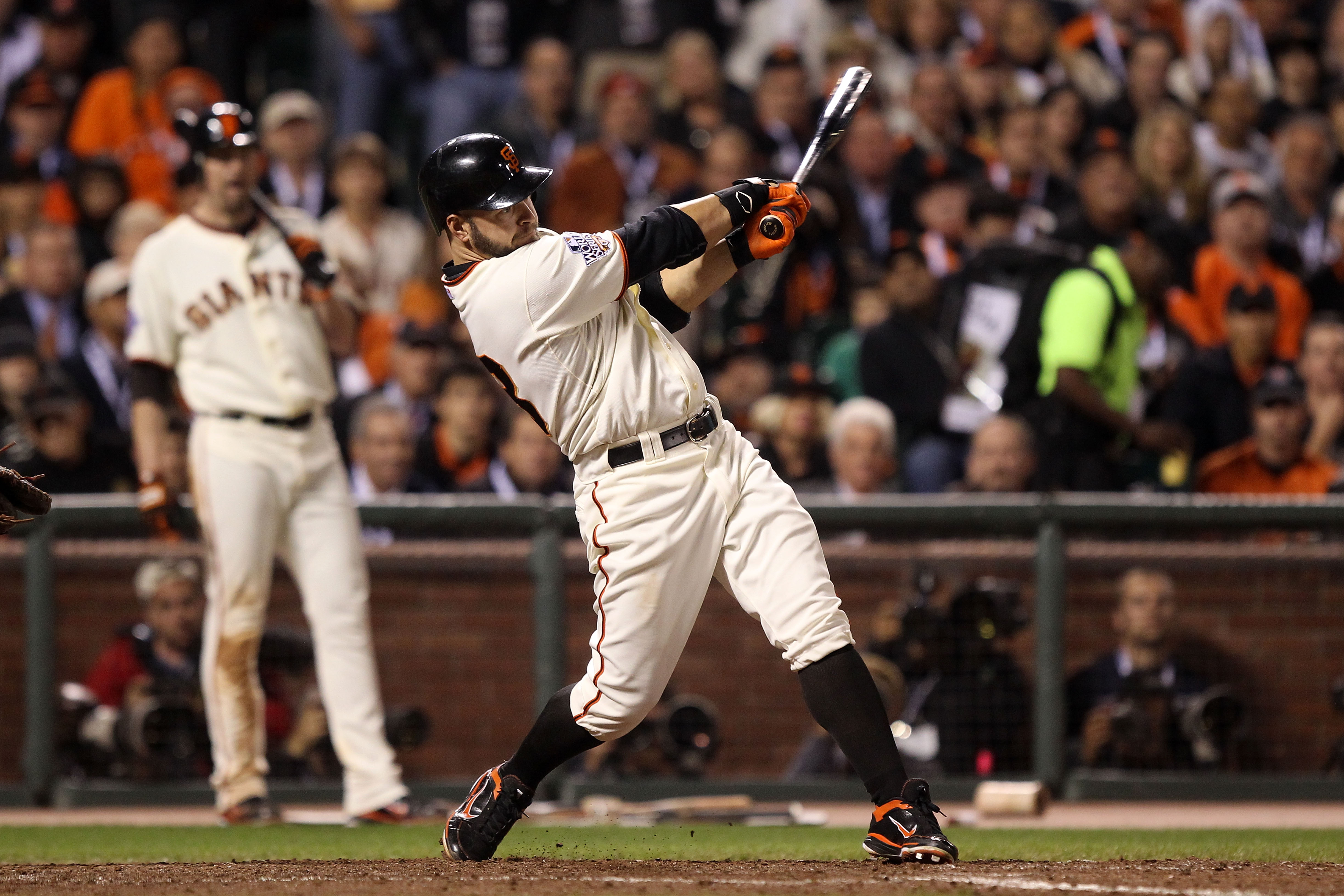 SAN FRANCISCO - OCTOBER 27:  Cody Ross #13 of the San Francisco Giants hits an RBI single against in the fifth inning against the Texas Rangers in Game One of the 2010 MLB World Series at AT&T Park on October 27, 2010 in San Francisco, California.  (Photo