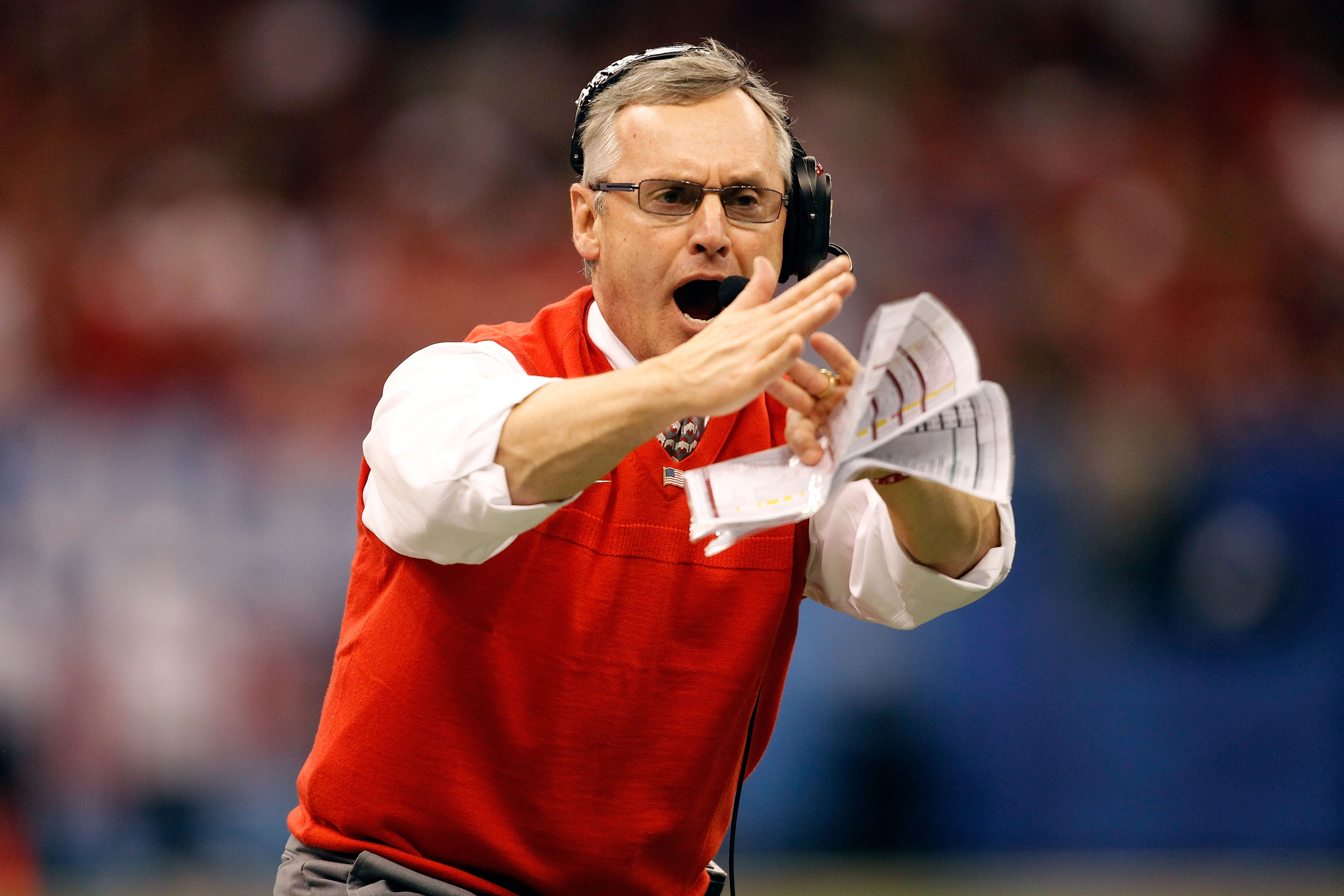 NEW ORLEANS, LA - JANUARY 04:  Head coach Jim Tressel of the Ohio State Buckeyes calls a time out in the first half against the Arkansas Razorbacks during the Allstate Sugar Bowl at the Louisiana Superdome on January 4, 2011 in New Orleans, Louisiana.  (P