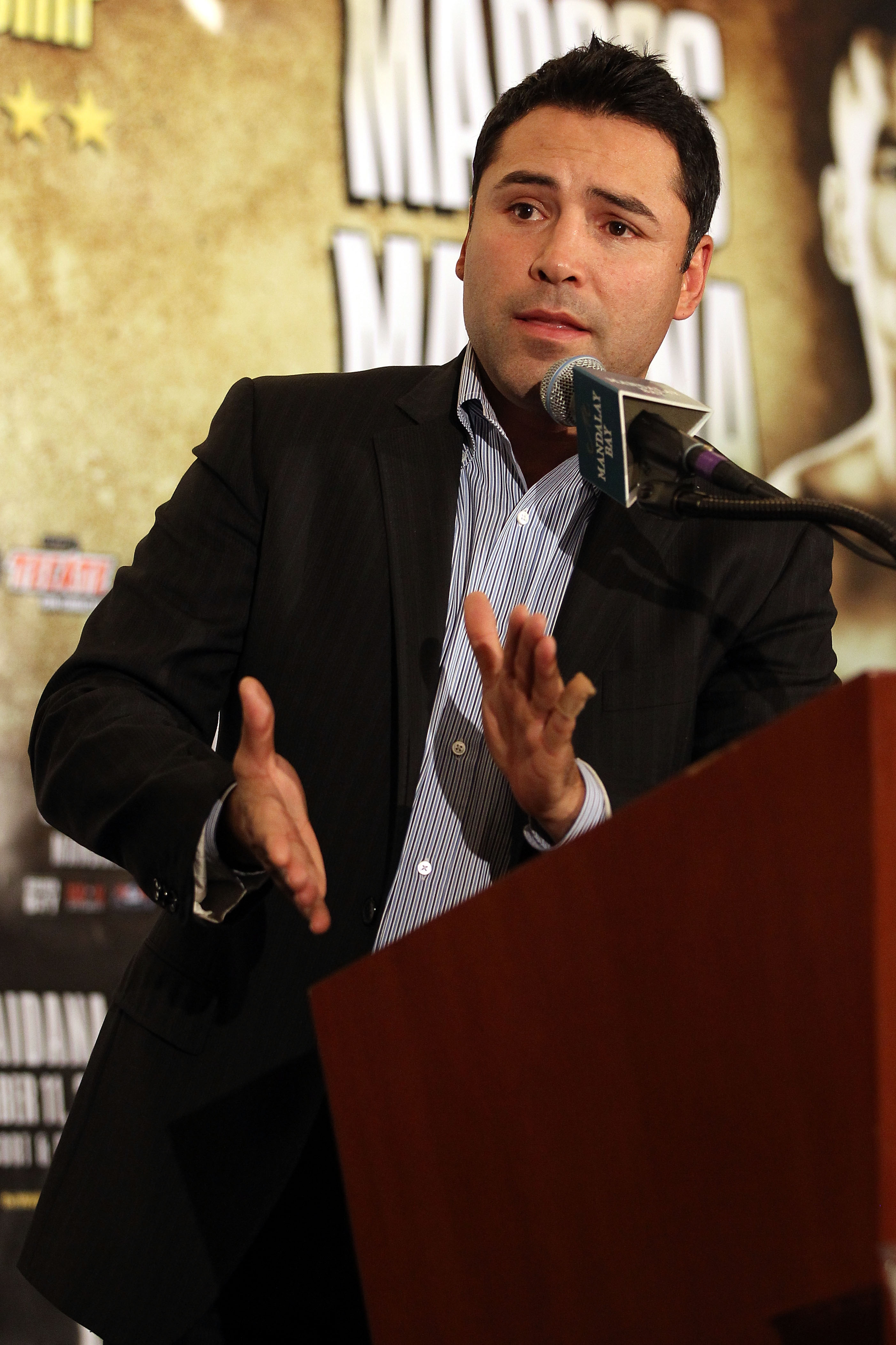 LAS VEGAS - DECEMBER 11:  Golden Boy Promotions President Oscar De La Hoya answers questions during the post-fight news conference after Amir Khan's unanimous decision victory against Marcos Maidana of Argentina after their WBA super lightweight title fig