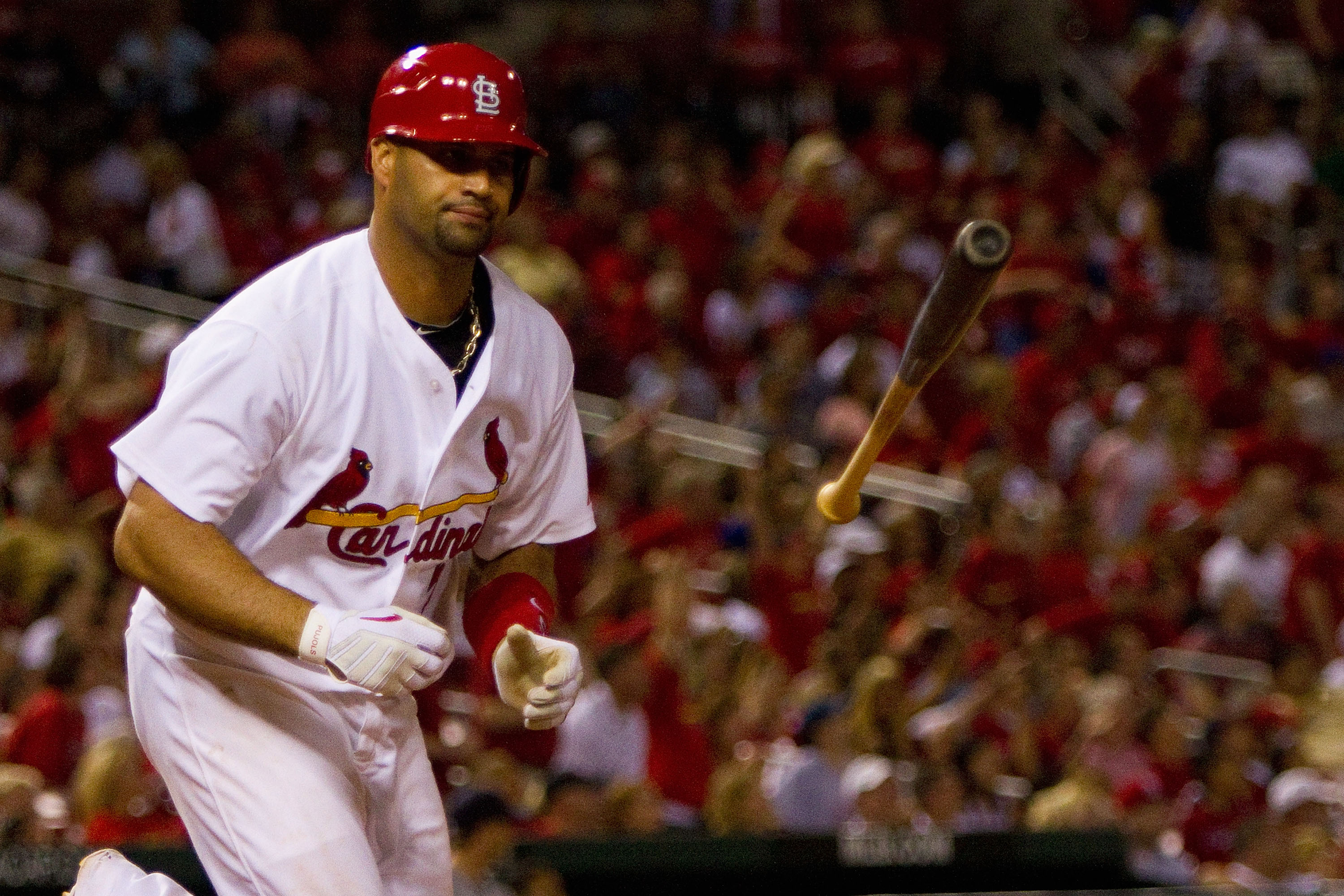 ST. LOUIS - JUNE 16: Albert Pujols #5 of the St. Louis Cardinals reacts to popping out against the Seattle Mariners at Busch Stadium on June 16, 2010 in St. Louis, Missouri.  (Photo by Dilip Vishwanat/Getty Images)