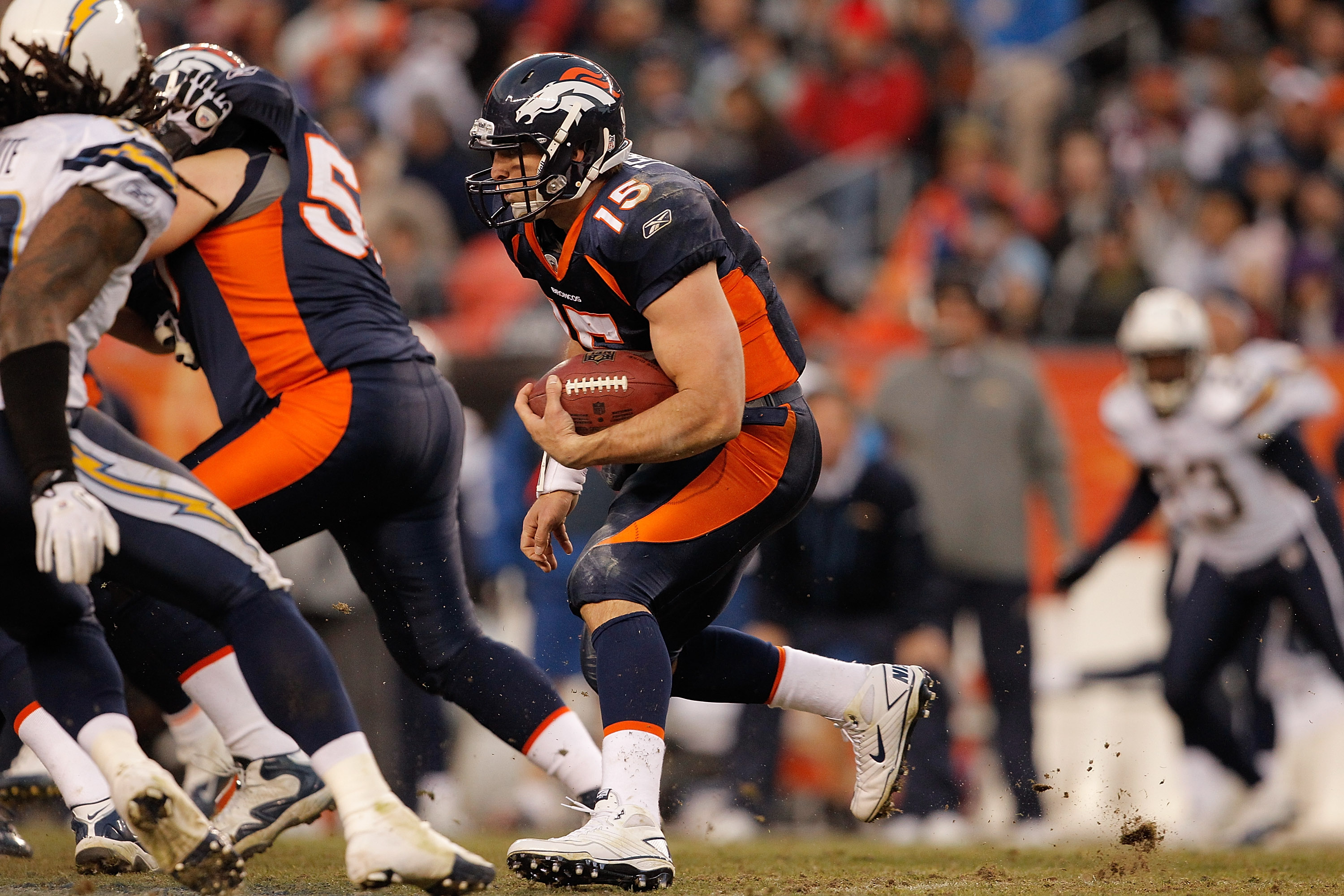 DENVER, CO - JANUARY 2:  Quarterback Tim Tebow #15 of the Denver Broncos looks for a hole in the line of the San Diego Chargers' defense during the fourth quarter at INVESCO Field at Mile High on January 2, 2011 in Denver, Colorado. (Photo by Justin Edmon