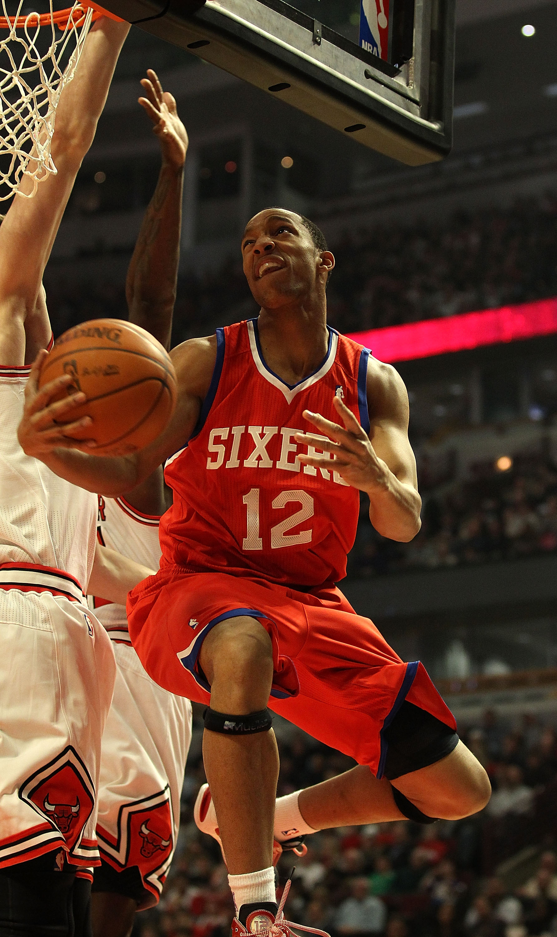 CHICAGO, IL - DECEMBER 21: Evan Turner #12 of the Philadelphia 76ers puts up a shot against the Chicago Bulls at the United Center on December 21, 2010 in Chicago, Illinois. NOTE TO USER: User expressly acknowledges and agrees that, by downloading and/or