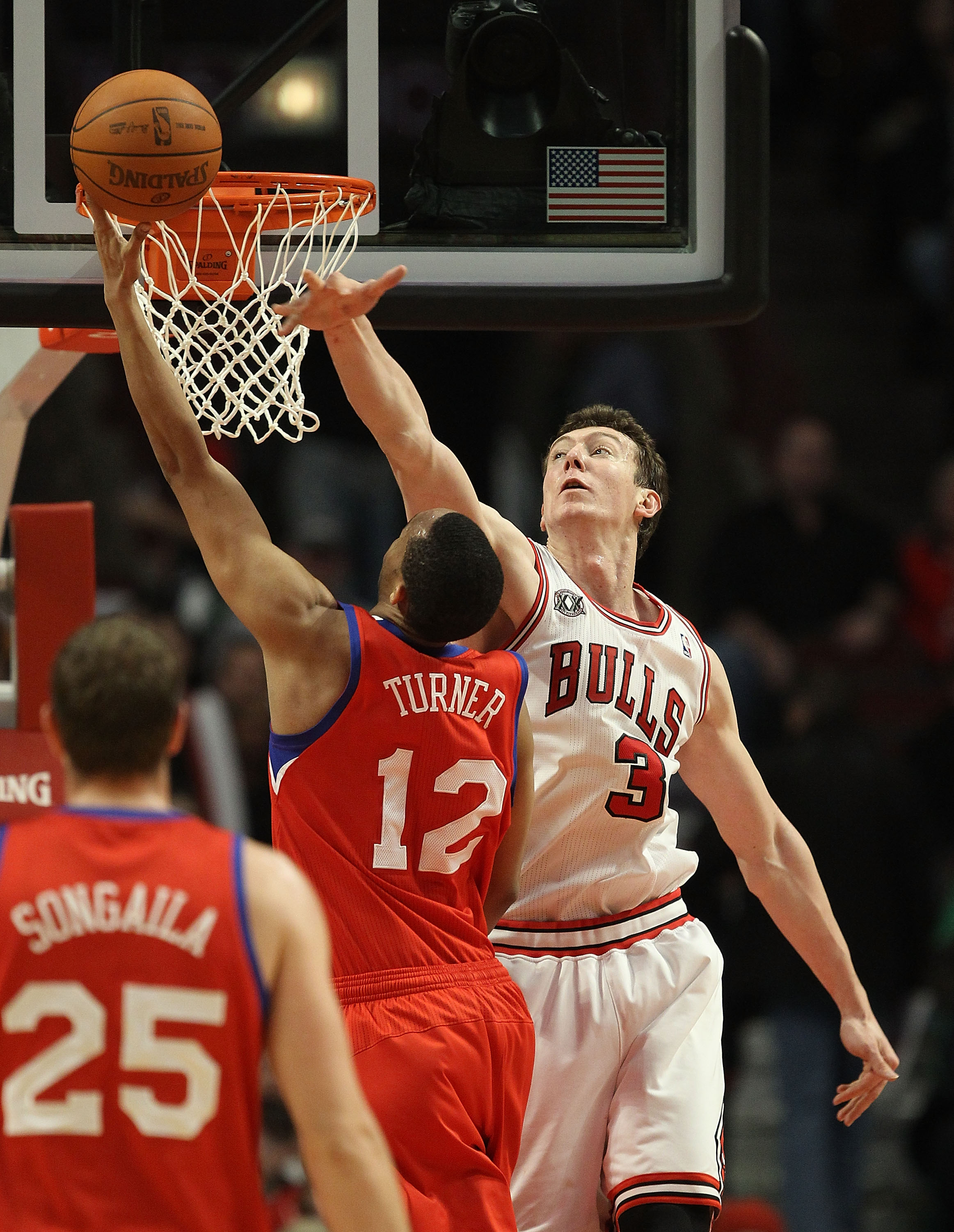 CHICAGO, IL - DECEMBER 21: Omer Asik #3 of the Chicago Bulls tries to block a shot by Evan Turner #12 of the Philadelphia 76ers at the United Center on December 21, 2010 in Chicago, Illinois. The Bulls defeated the 76ers 121-76. NOTE TO USER: User express