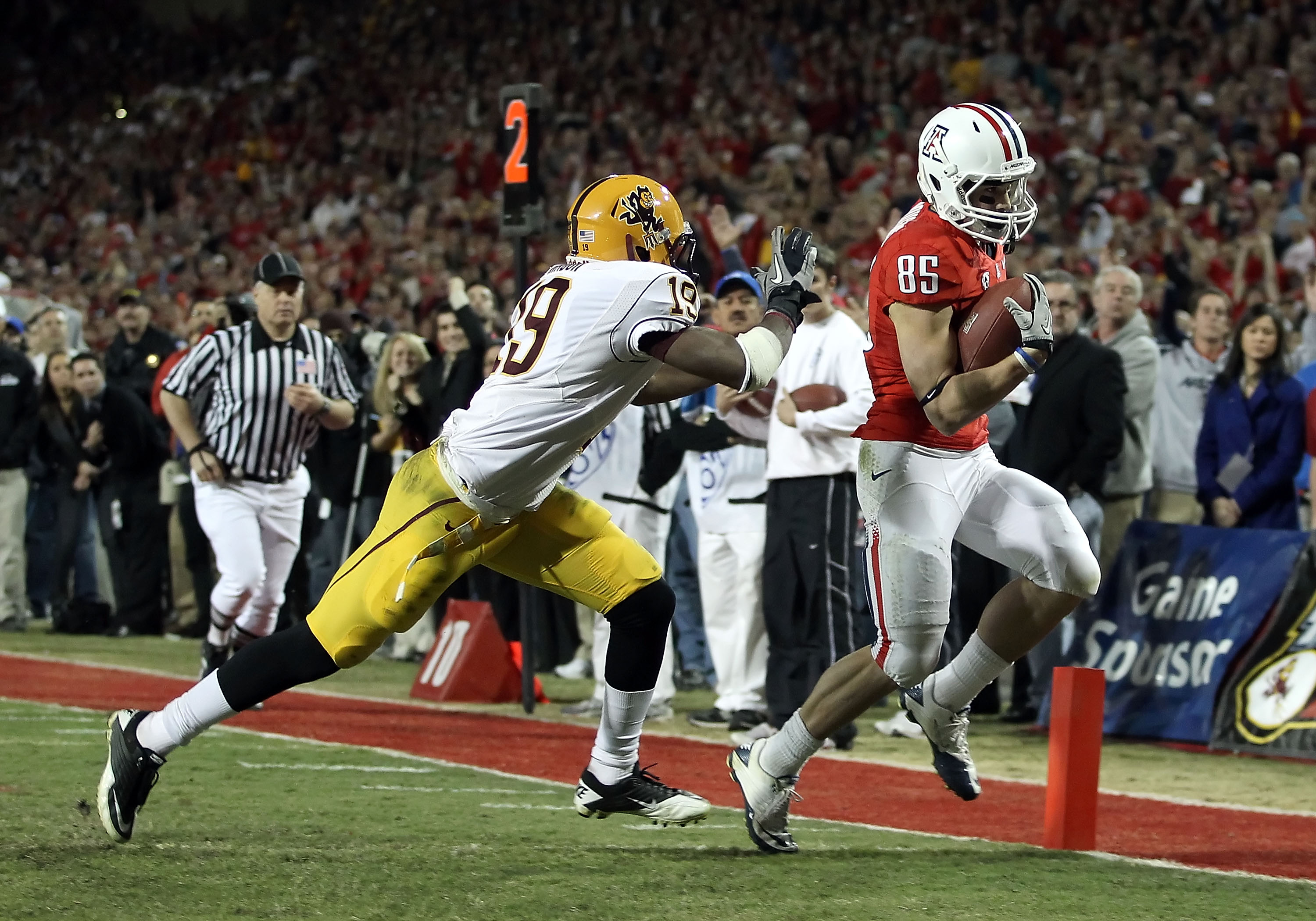 TUCSON, AZ - DECEMBER 02:  Wide receiver David Douglas #85 of the Arizona Wildcats scores a touchdown reception against the Arizona State Sun Devils during the college football game at Arizona Stadium on December 2, 2010 in Tucson, Arizona.   The Sun Devi