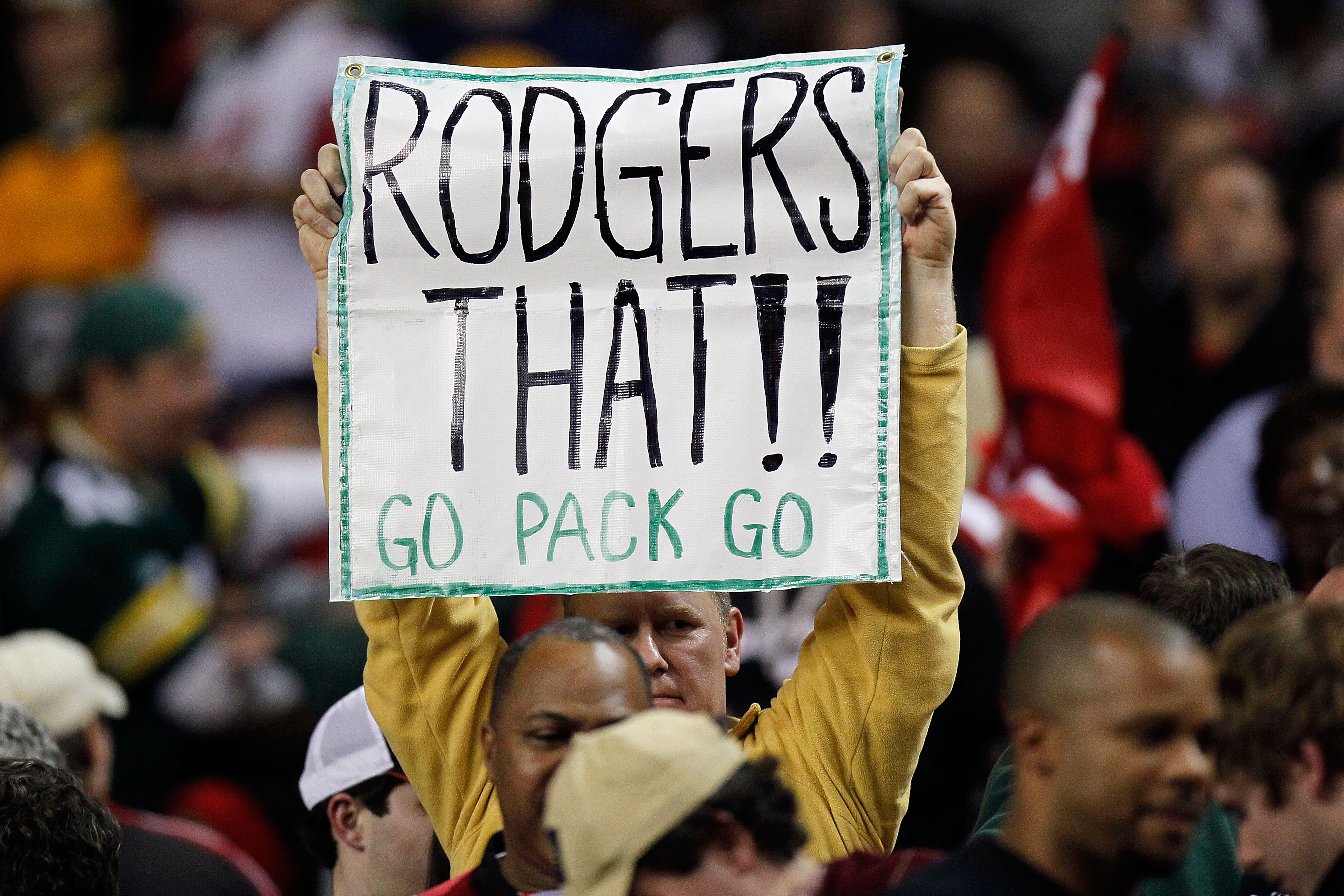ATLANTA, GA - JANUARY 15:  A fan of the Green Bay Packers holds up a sign which reads 'Rodgers THat Go Pack Go' against the Atlanta Falcons during their 2011 NFC divisional playoff game at Georgia Dome on January 15, 2011 in Atlanta, Georgia.  (Photo by K