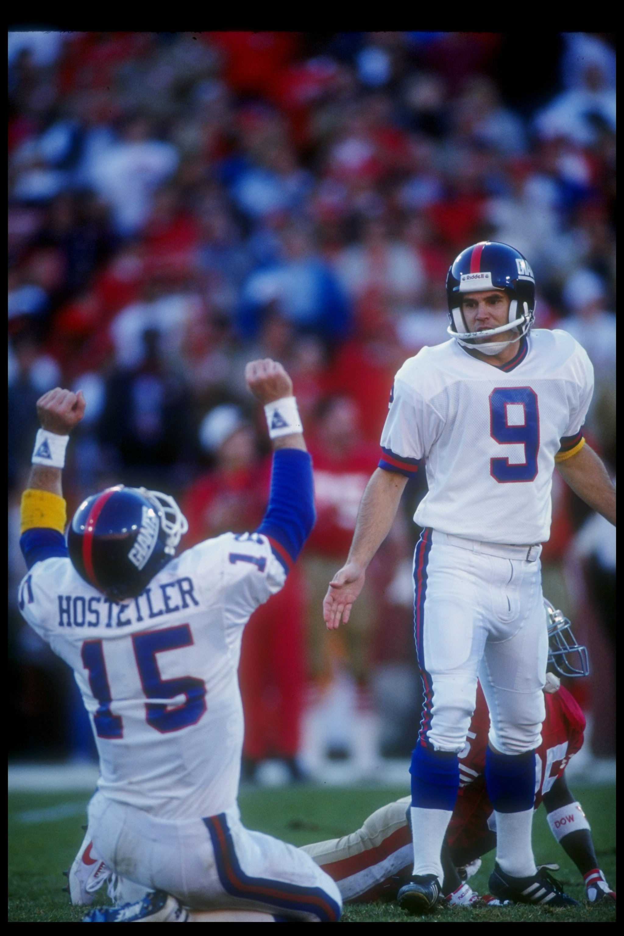 20 Jan 1991:  Quarterback Jeff Hostetler of the New York Giants (left) celebrates after kicker Matt Bahr kicked the winning field goal during a playoff game against the San Francisco 49ers at Candlestick Park in San Francisco, California.  The Giants won