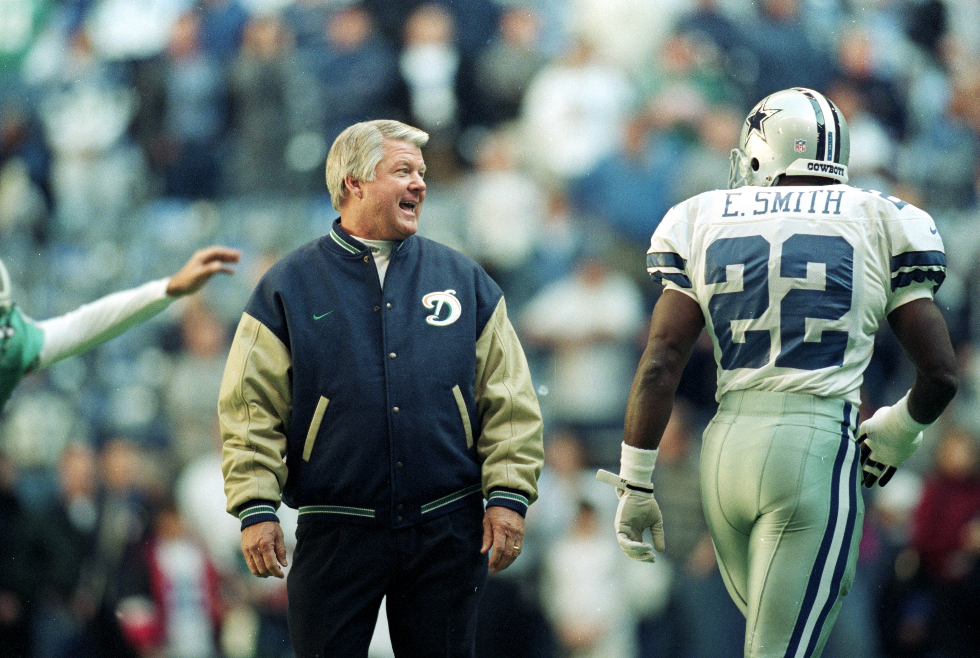 25 Nov 1999: Coach Jimmy Johnson of the Miami Dolphins talks to Emmitt Smith #22 of the Dallas Cowboys as he walks onto the field during the game at the Texas Stadium in Irving, Texas. The Cowboys defeated the Dolphins 20-0.