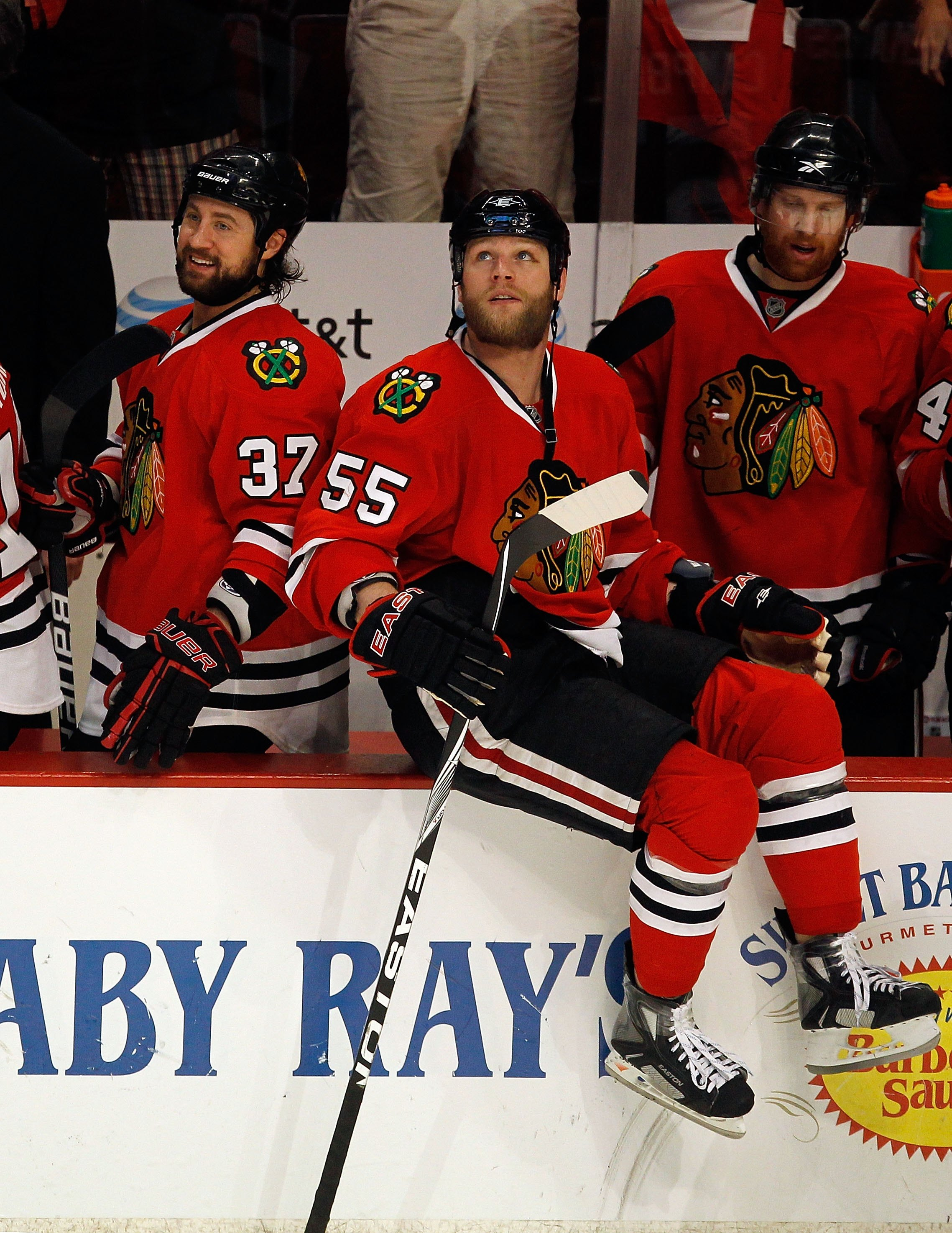CHICAGO - MAY 23:  Adam Burish #37 and Ben Eager #55 of the Chicago Blackhawks look on from the bench while taking on the San Jose Sharks in Game Four of the Western Conference Finals during the 2010 NHL Stanley Cup Playoffs at the United Center on May 23