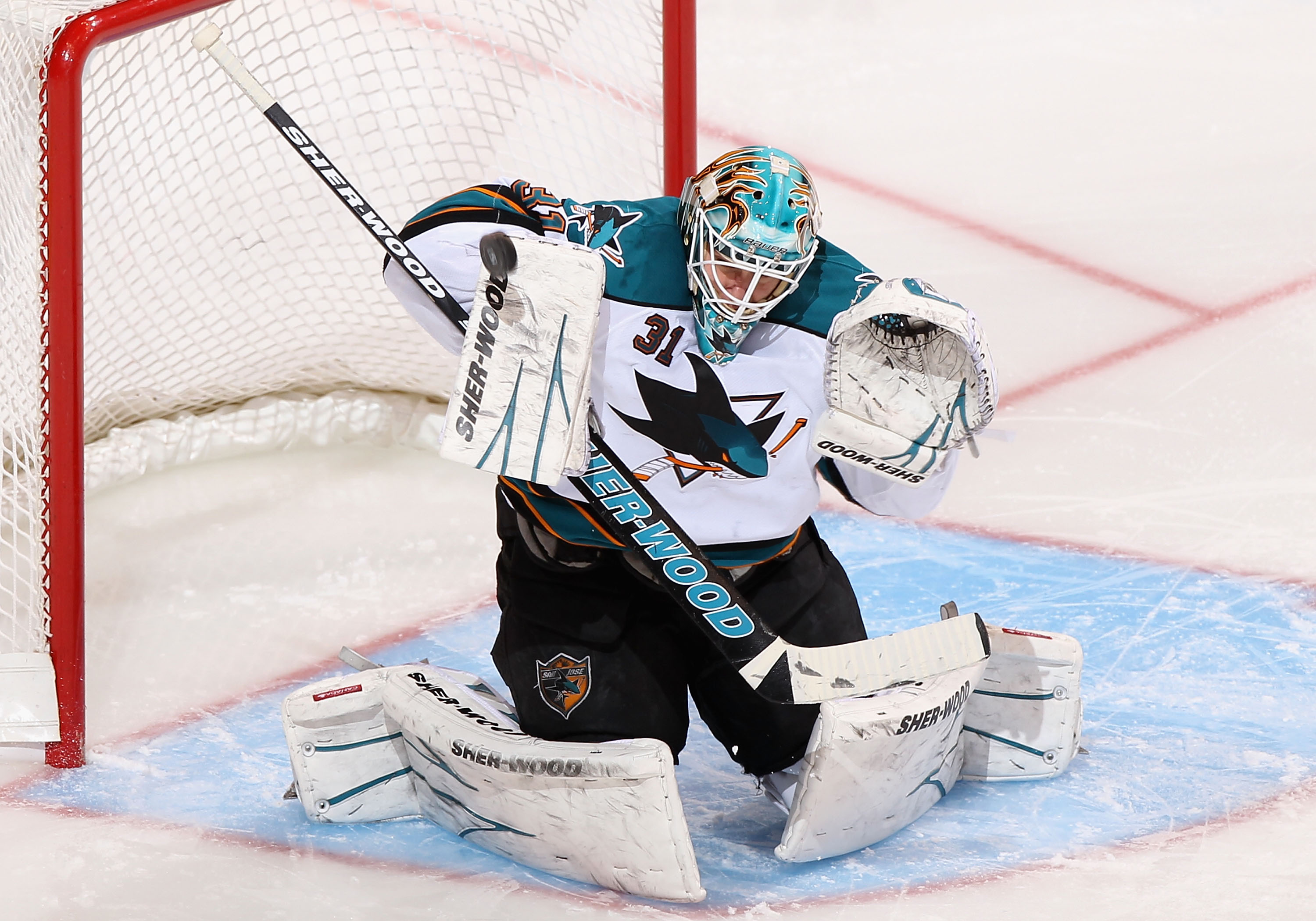 GLENDALE, AZ - JANUARY 17:  Goaltender Antti Niemi #31 of the San Jose Sharks makes a blocker save on the shot from the Phoenix Coyotes during the second period of the NHL game at Jobing.com Arena on January 17, 2011 in Glendale, Arizona.  (Photo by Chris