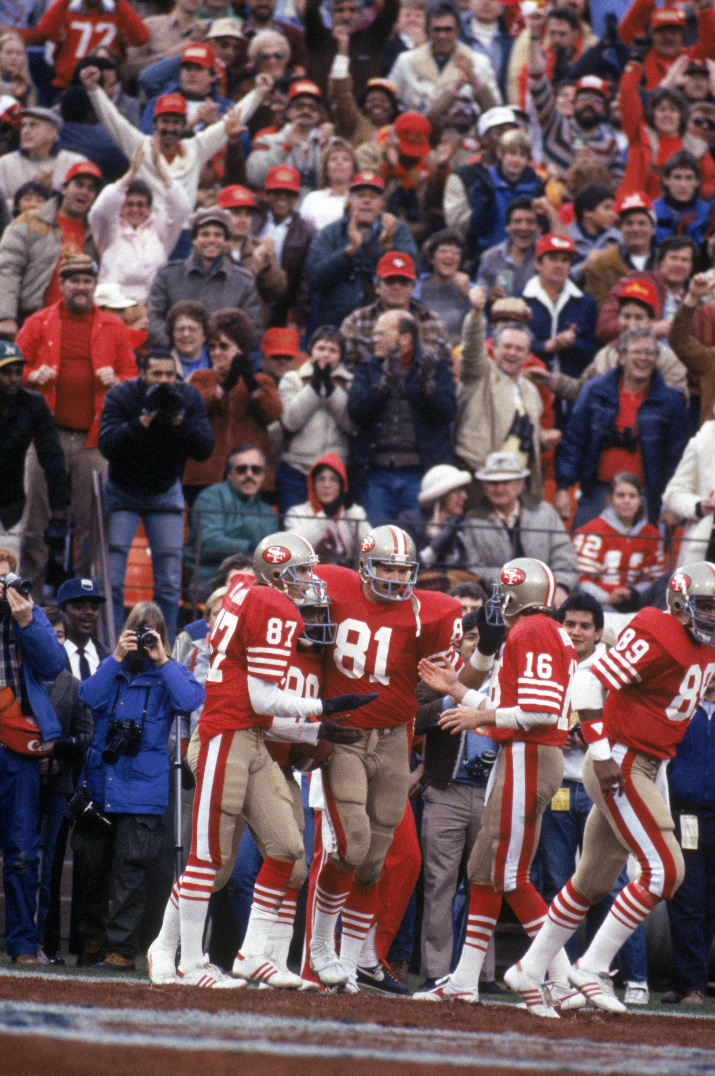SAN FRANCISCO - JANUARY 6:  Wide receiver Dwight Clark #87, tight end Russ Francis #81 and quarterback Joe Montana #16 of the San Francisco 49ers celebrate during the 1984 NFC Championship Game against the Chicago Bears at Candlestick Park on January 6, 1