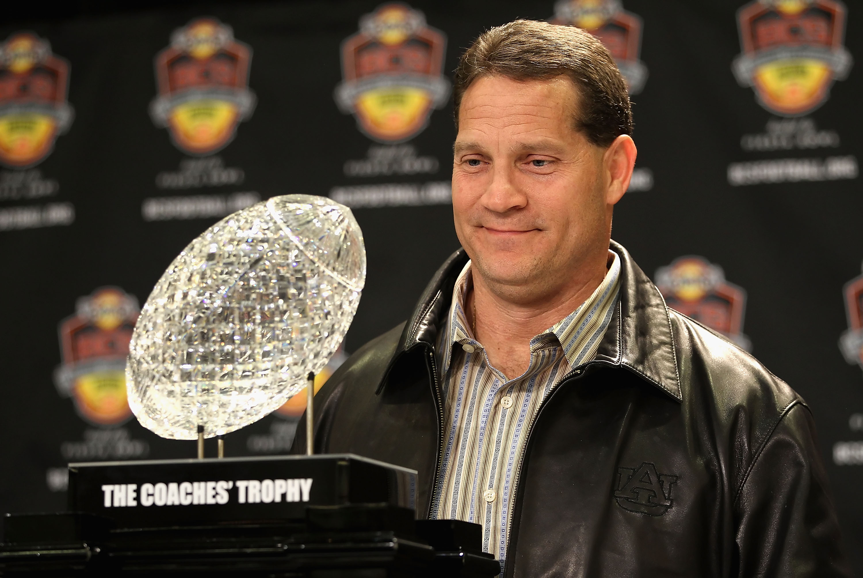 SCOTTSDALE, AZ - JANUARY 11:  Head coach Gene Chizik of the Auburn Tigers poses with the Coaches trophys during a press conference for the Tostitos BCS National Championship Game at the JW Marriott Camelback Inn on January 11, 2011 in Scottsdale, Arizona.