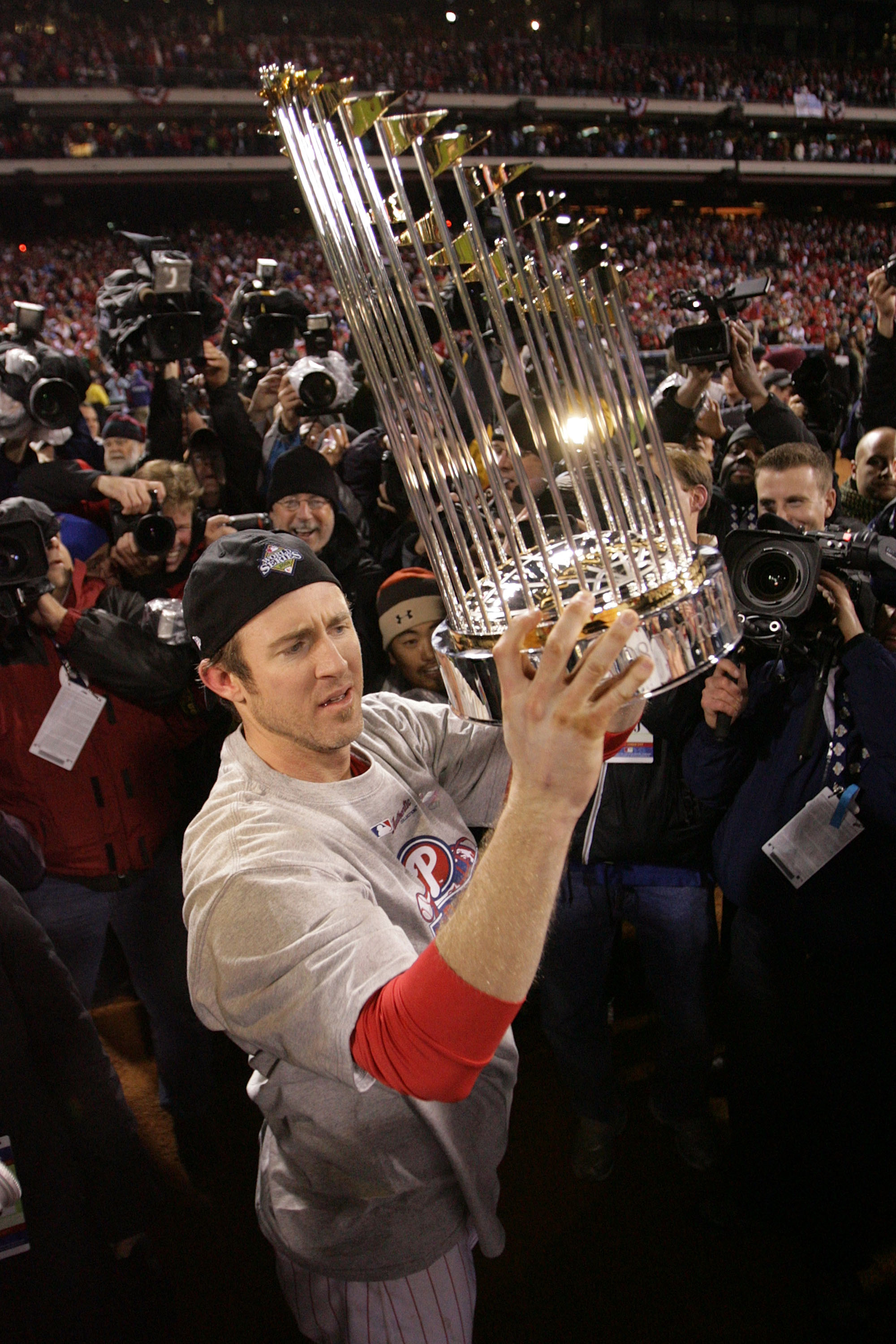 PHILADELPHIA - OCTOBER 29:  Chase Utley #26 of the Philadelphia Phillies celebrates with the World Series trophy after their 4-3 win against the Tampa Bay Rays during the continuation of game five of the 2008 MLB World Series on October 29, 2008 at Citize