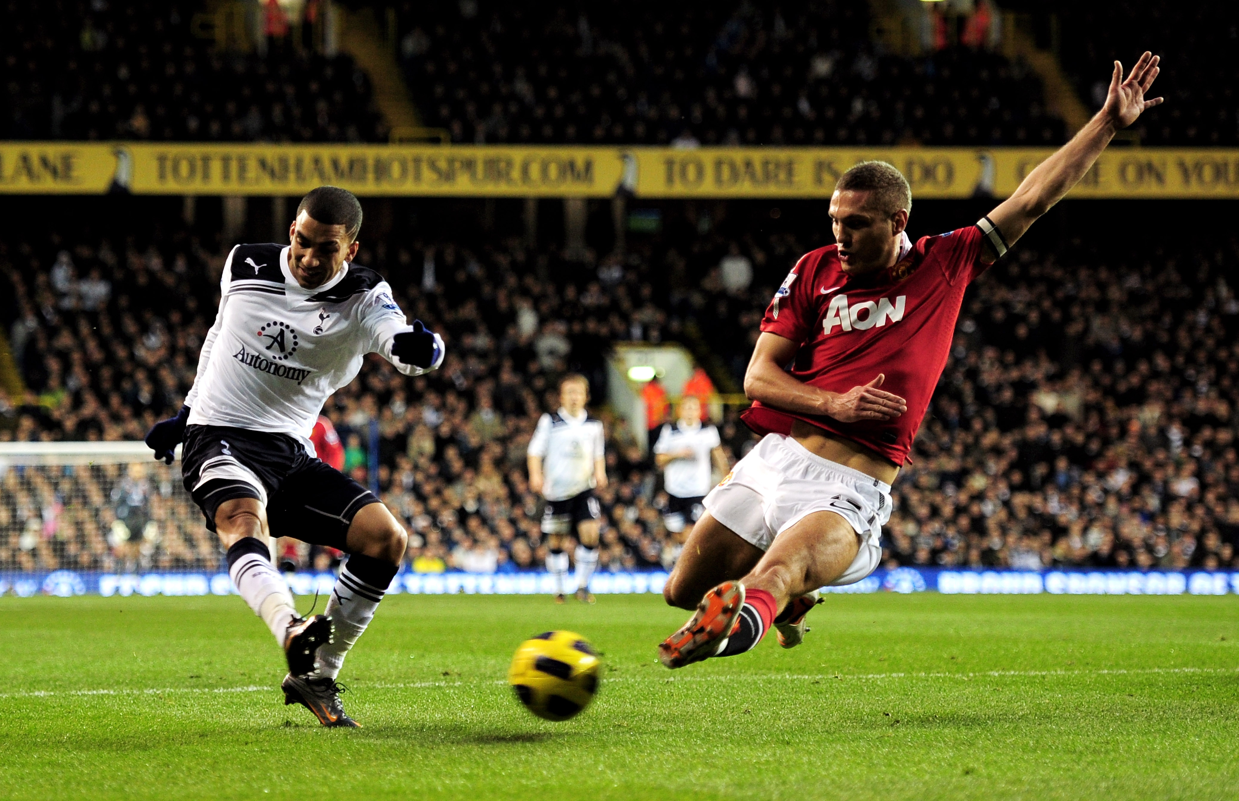 LONDON, ENGLAND - JANUARY 16:  Aaron Lennon of Spurs attempts to cross the ball as Nemanja Vidic of Manchester United closes in during the Barclays Premier League match between Tottenham Hotspur and Manchester United at White Hart Lane on January 16, 2011
