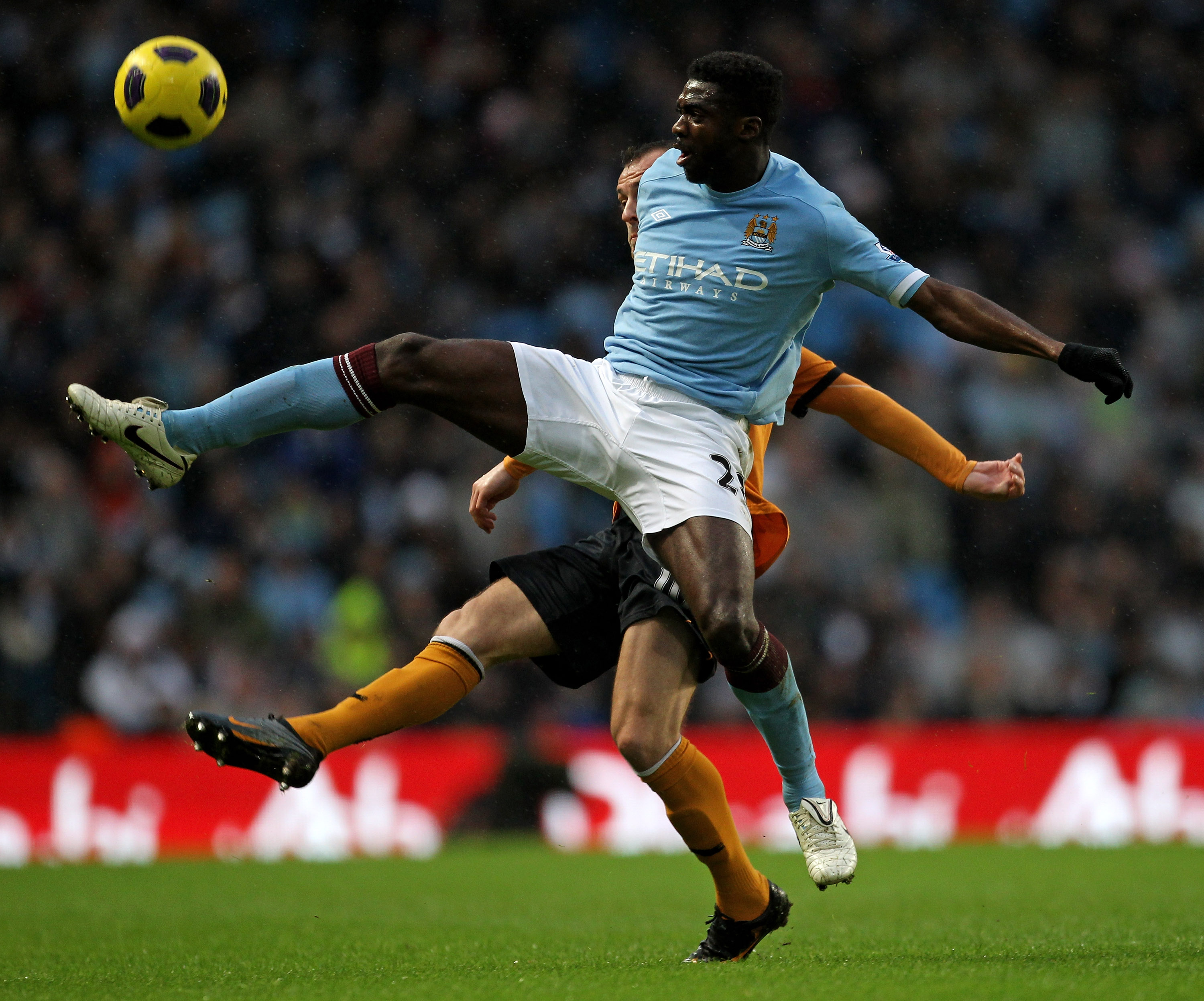 MANCHESTER, UNITED KINGDOM - JANUARY 15:   Steven Fletcher of Wolverhampton Wanderers competes with Kolo Toure of Manchester City during the Barclays Premier League match between Manchester City and Wolverhampton Wanderers at the City of Manchester Stadiu