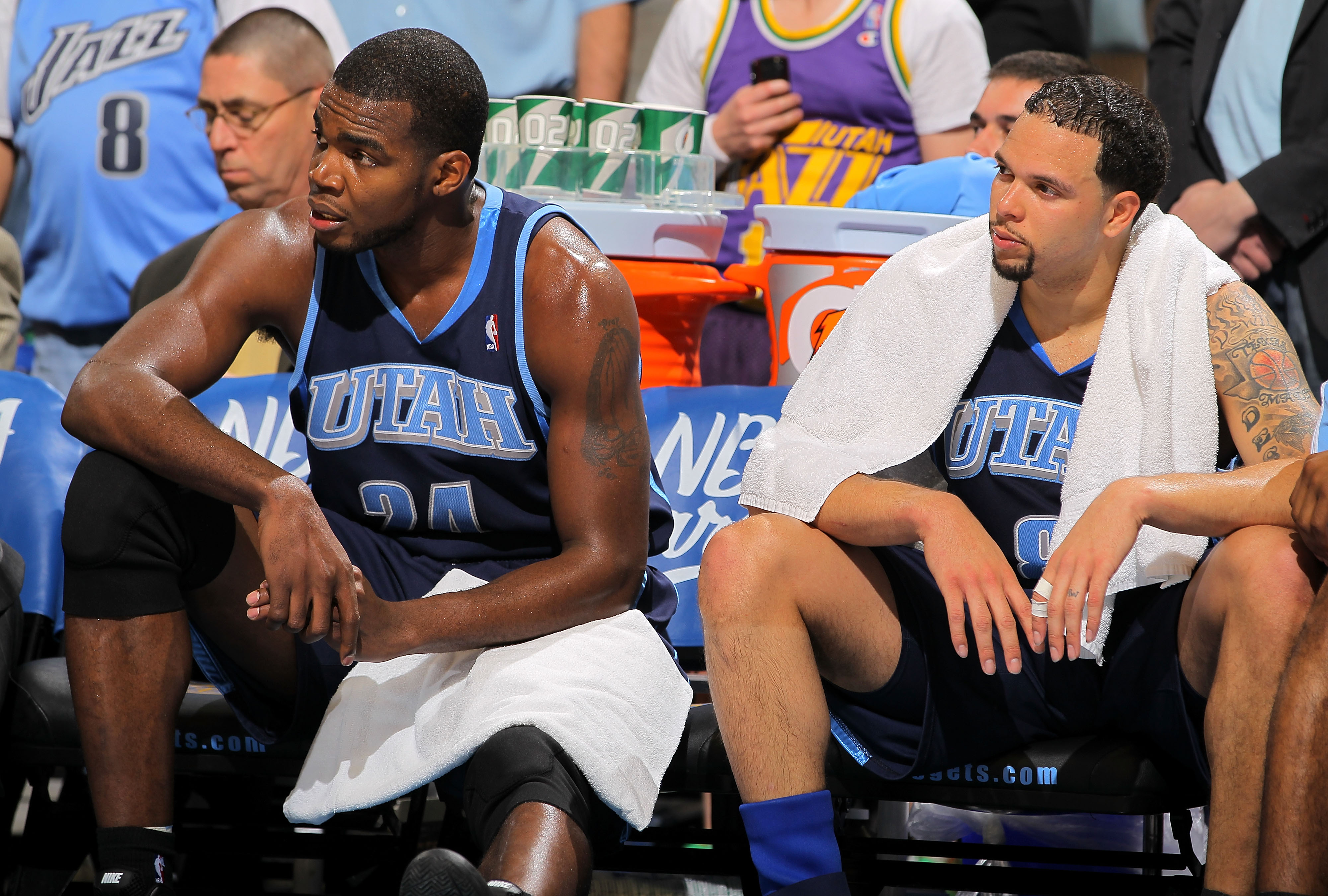 DENVER - APRIL 28:  Paul Millsap #24 and Deron Williams #8 of the Utah Jazz sit on the bench in the closing minutes against the Denver Nuggets in Game Five of the Western Conference Quarterfinals of the 2010 NBA Playoffs at the Pepsi Center on April 28, 2