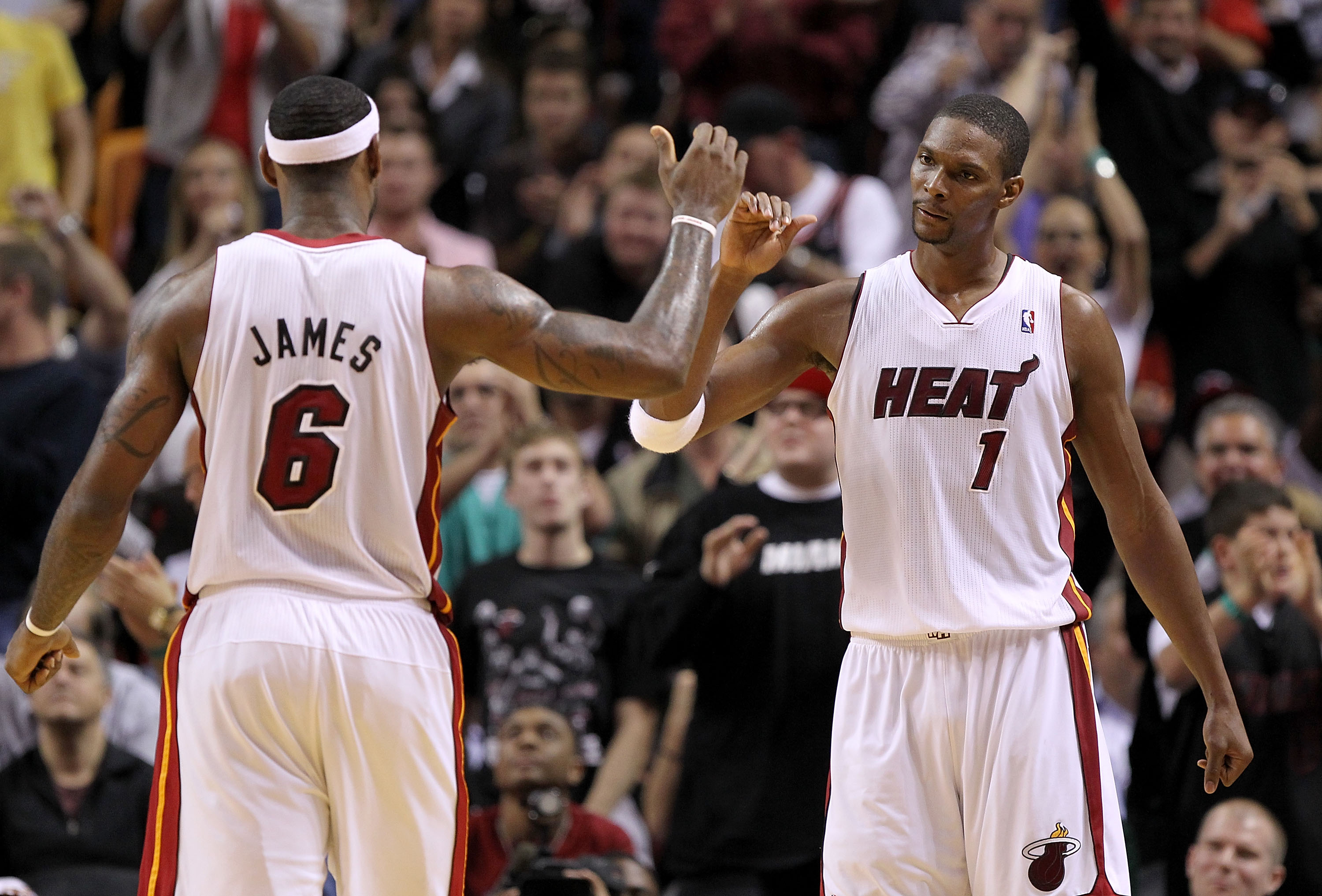 MIAMI, FL - DECEMBER 20: LeBron James #6 and Chris Bosh #1 of the Miami Heat high five during a game against the Dallas Mavericks at American Airlines Arena on December 20, 2010 in Miami, Florida. NOTE TO USER: User expressly acknowledges and agrees that,