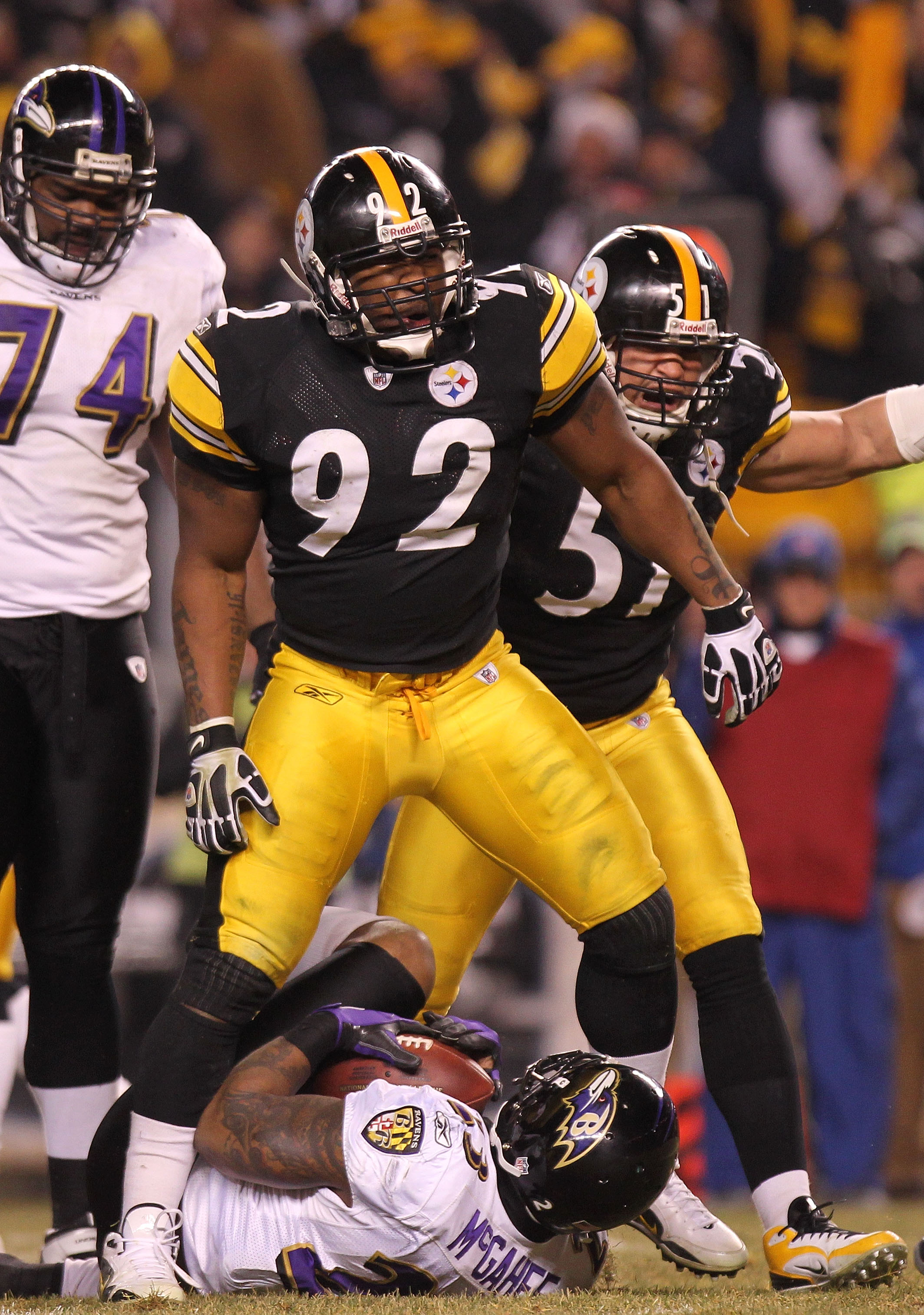 PITTSBURGH, PA - JANUARY 15:  Linebacker James Harrison #92 of the Pittsburgh Steelers celebrates after stopping running back Willis McGahee #23 of the Baltimore Ravens on a play during the AFC Divisional Playoff Game at Heinz Field on January 15, 2011 in