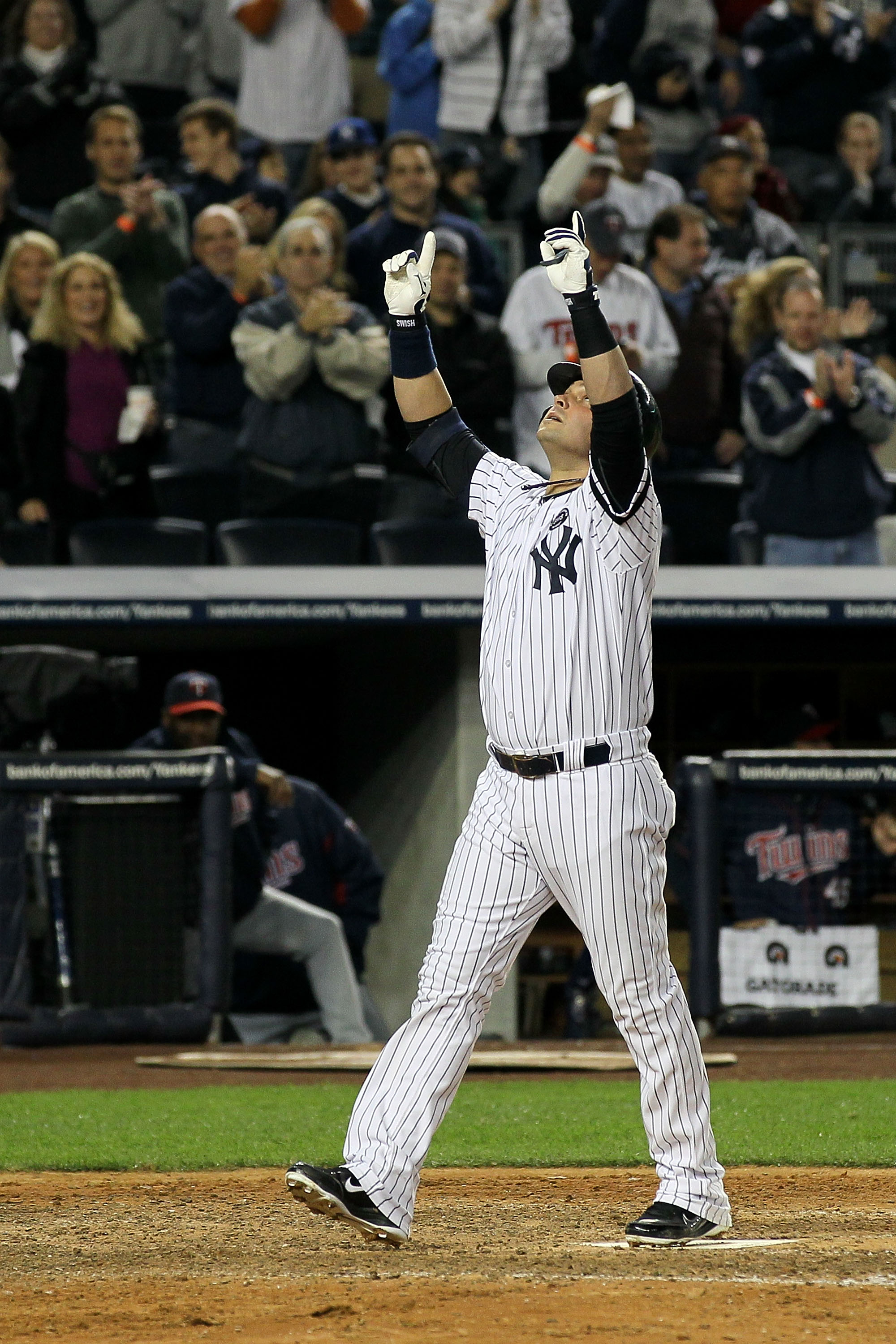 NEW YORK - OCTOBER 09:  Nick Swisher #33 of the New York Yankees celebrates as he crosses home plate after he hit a solo home run in the bottom of the seventh inning against the Minnesota Twins during Game Three of the ALDS part of the 2010 MLB Playoffs a