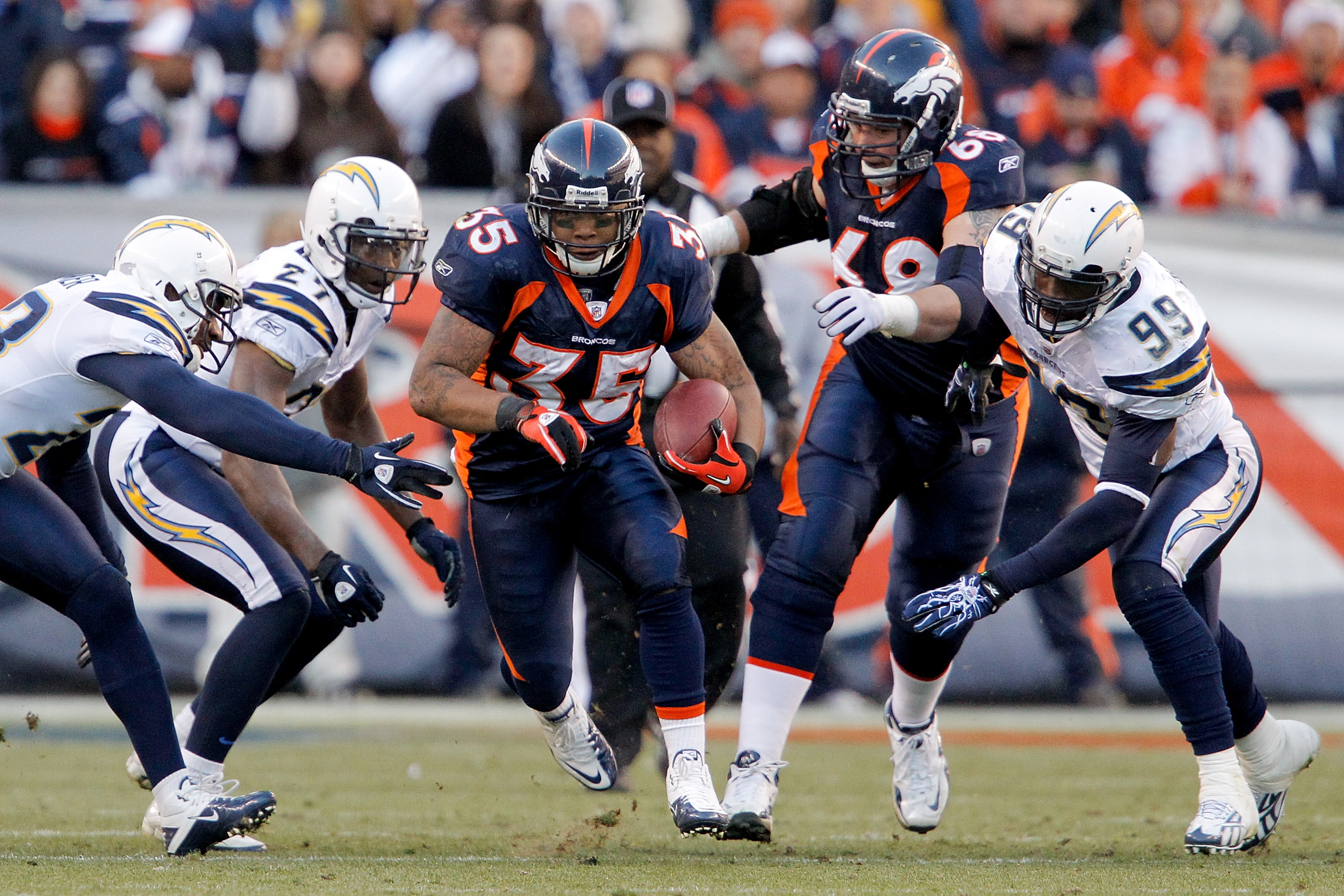 DENVER, CO - JANUARY 2:  Running back Lance Ball #35 of the Denver Broncos breaks through a hole of San Diego defenders during the second quarter at INVESCO Field at Mile High on January 2, 2011 in Denver, Colorado. (Photo by Justin Edmonds/Getty Images)