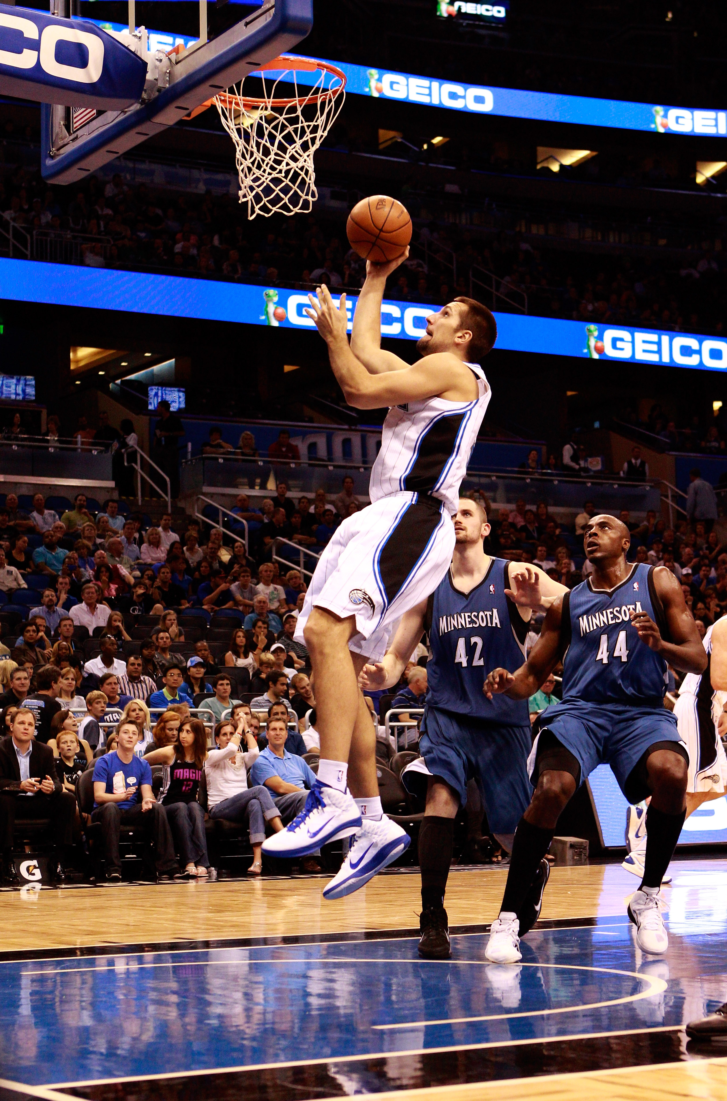 ORLANDO, FL - NOVEMBER 03:  Ryan Anderson #33 of the Orlando Magic attempts a shot over Anthony Tolliver #44 of the Minnesota Timberwolves during the game at Amway Arena on November 3, 2010 in Orlando, Florida.  NOTE TO USER: User expressly acknowledges a
