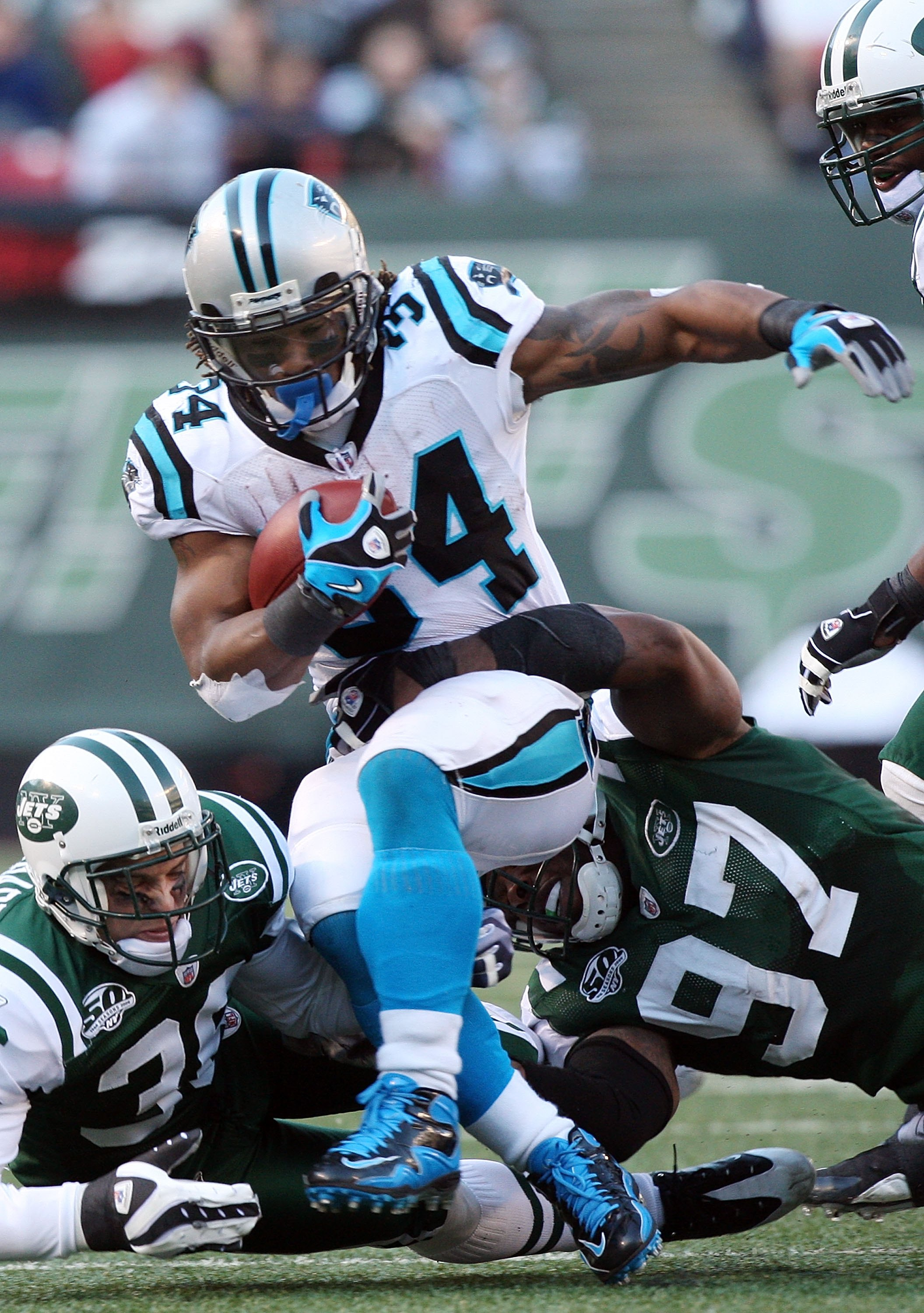 EAST RUTHERFORD, NJ - NOVEMBER 29: DeAngelo Williams #34 of the Carolina Panthers runs the ball against the New York Jetson November 29, 2009 at Giants Stadium in East Rutherford, New Jersey. The Jets defeated the Panthers 17-6.  (Photo by Jim McIsaac/Get