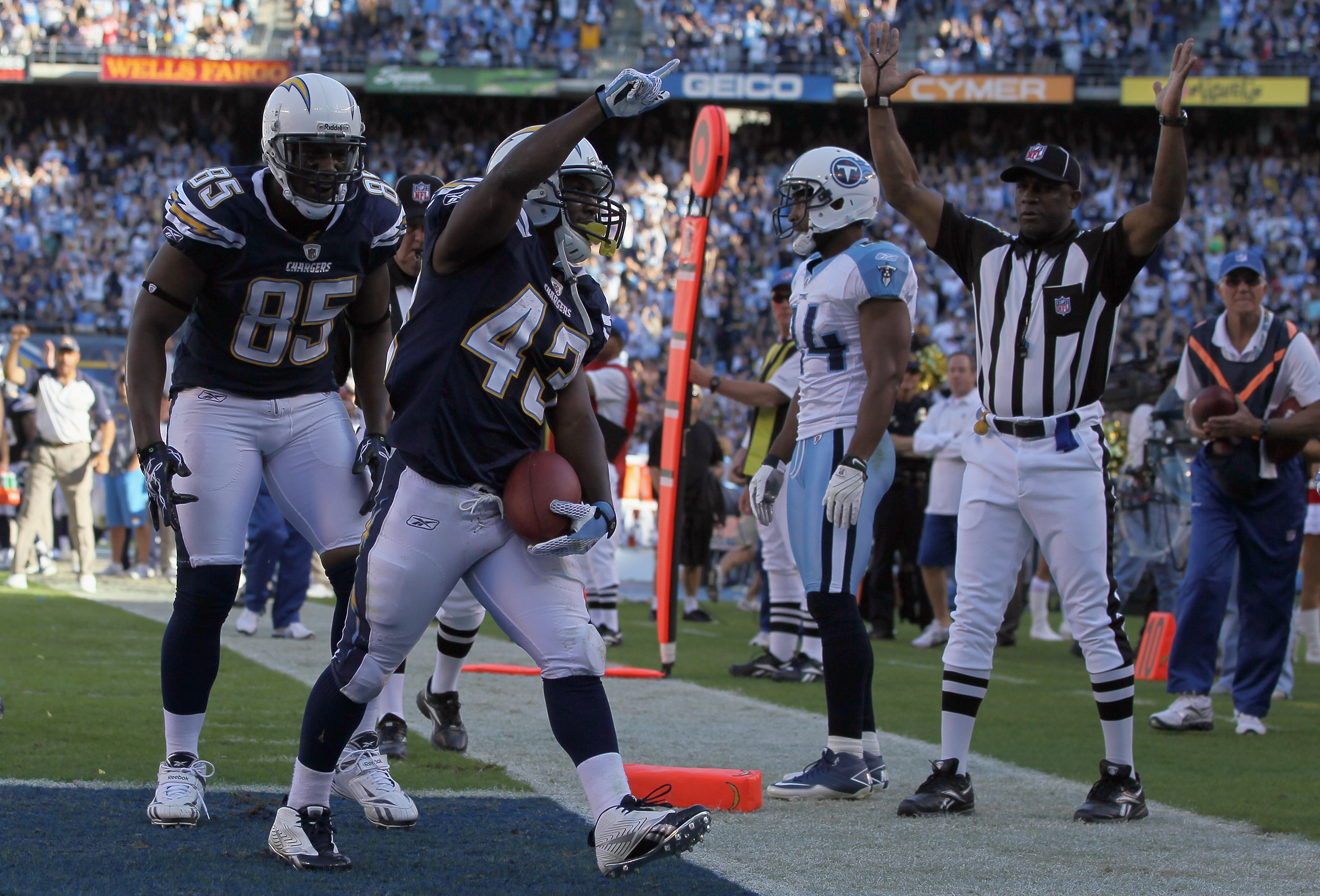 SAN DIEGO - OCTOBER 31:  Tight end Antonio Gates (L) #85 and Running back Darren Sproles #43 of the San Diego Chargers celebrate Sproles' touchdown against the Tennessee Titans in the fourth quarter at Qualcomm Stadium on October 31, 2010 in San Diego, Ca