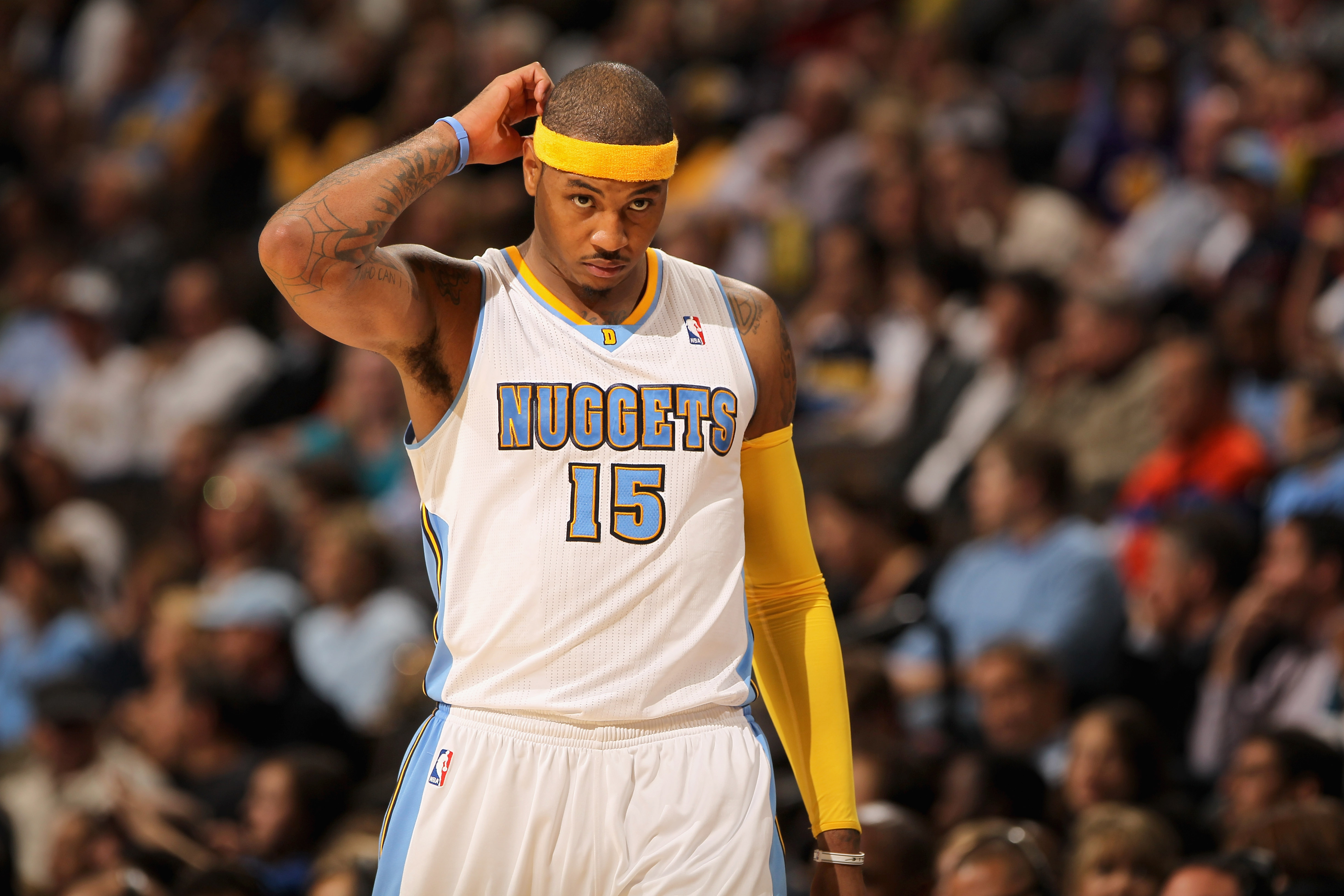 DENVER - NOVEMBER 11:  Carmelo Anthony #15 of the Denver Nuggets looks on during a break in the action against the Los Angeles Lakers at the Pepsi Center on November 11, 2010 in Denver, Colorado. The Nuggets defeated the Lakers 118-112.  NOTE TO USER: Use