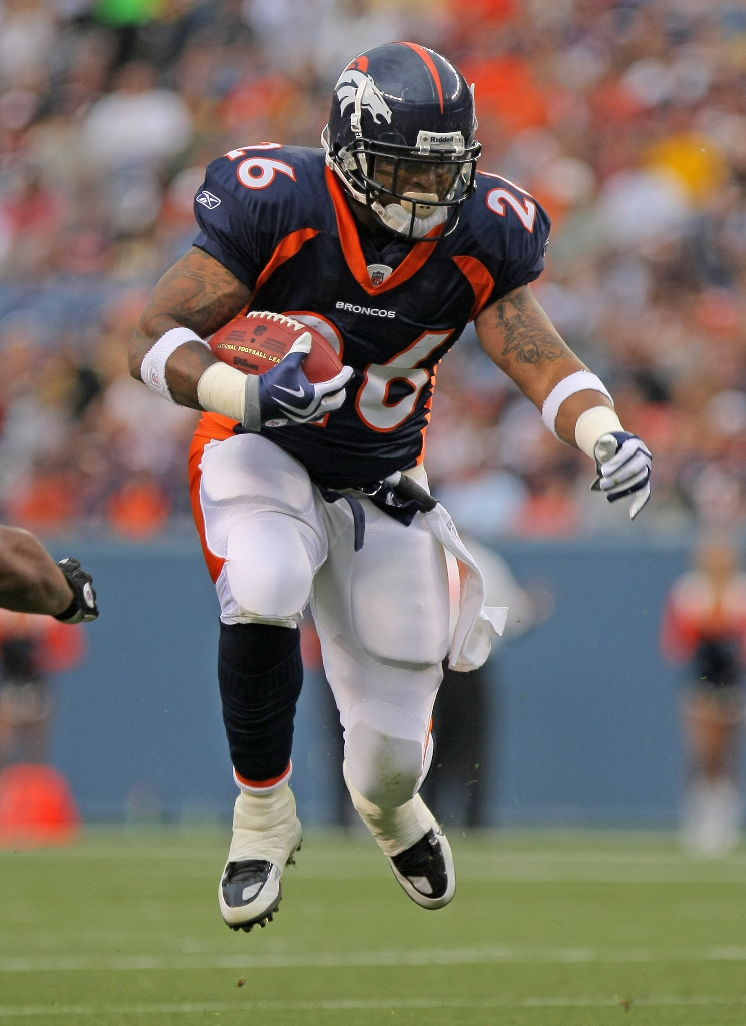 DENVER - AUGUST 29:  Running back LenDale White #26 of the Denver Broncos rushes against the Pittsburgh Steelers during preseason NFL action at INVESCO Field at Mile High on August 29, 2010 in Denver, Colorado.  (Photo by Doug Pensinger/Getty Images)