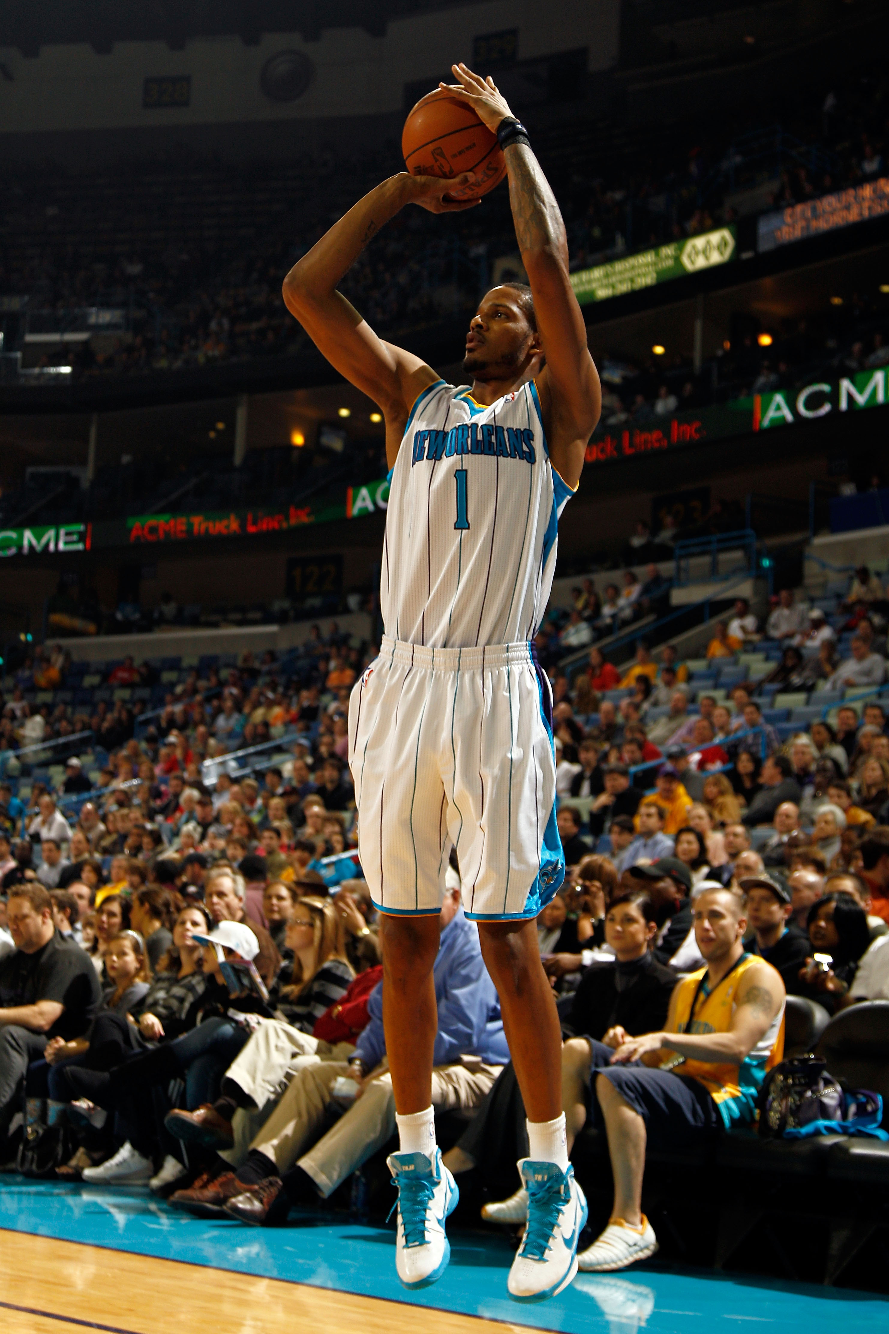 NEW ORLEANS, LA - JANUARY 03:  Trevor Ariza #1 of the New Orleans Hornets shoots a three-pointer against the Philadelphia 76ers at New Orleans Arena on January 3, 2011 in New Orleans, Louisiana. NOTE TO USER: User expressly acknowledges and agrees that, b