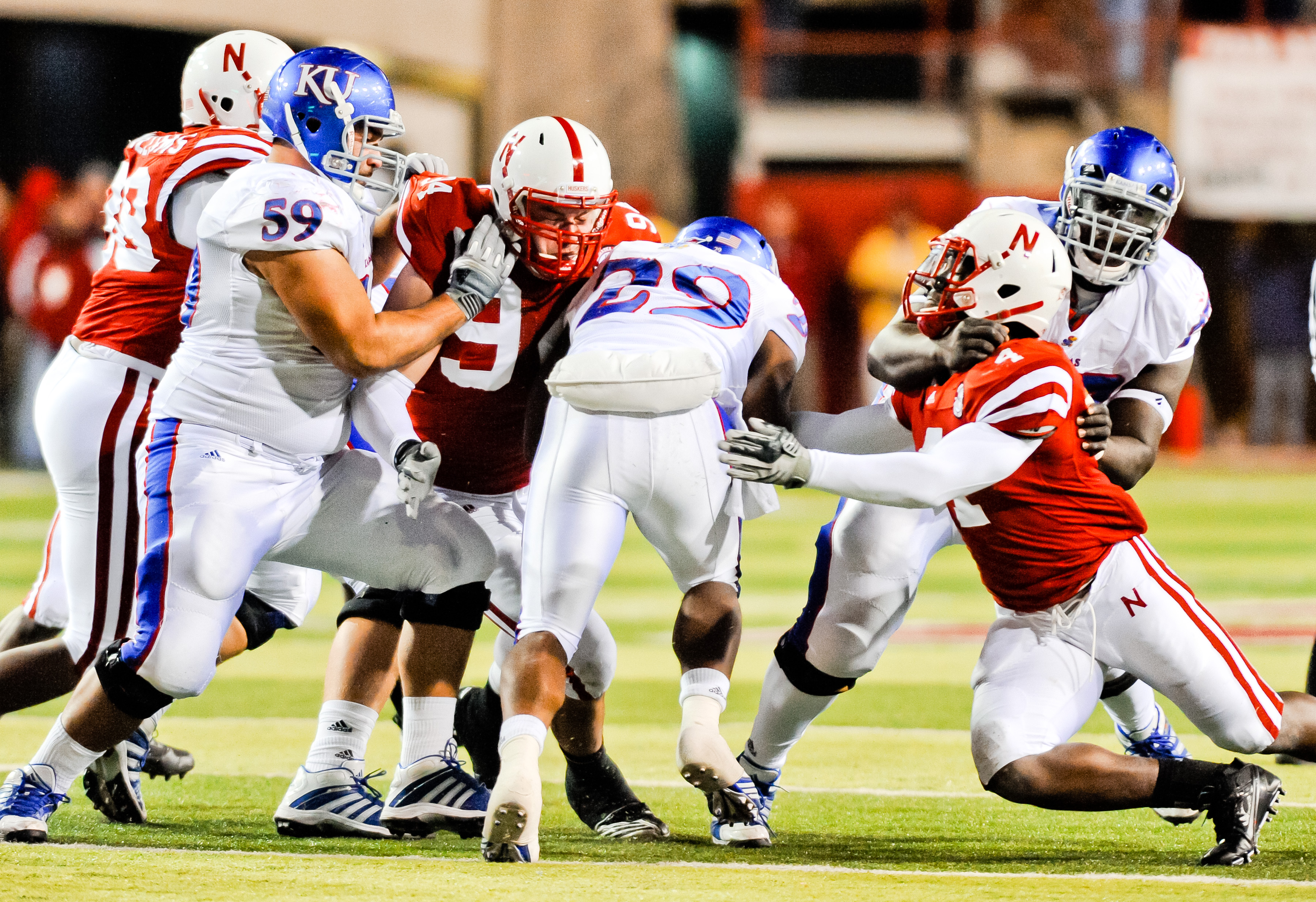 LINCOLN, NE - NOVEMBER 13: James Sims #29 of the Kansas Jayhawks leans for extra yards against the Nebraska Cornhusker defense during their game at Memorial Stadium on November 13, 2010 in Lincoln, Nebraska. Nebraska Defeated Kansas 20-3. (Photo by Eric F