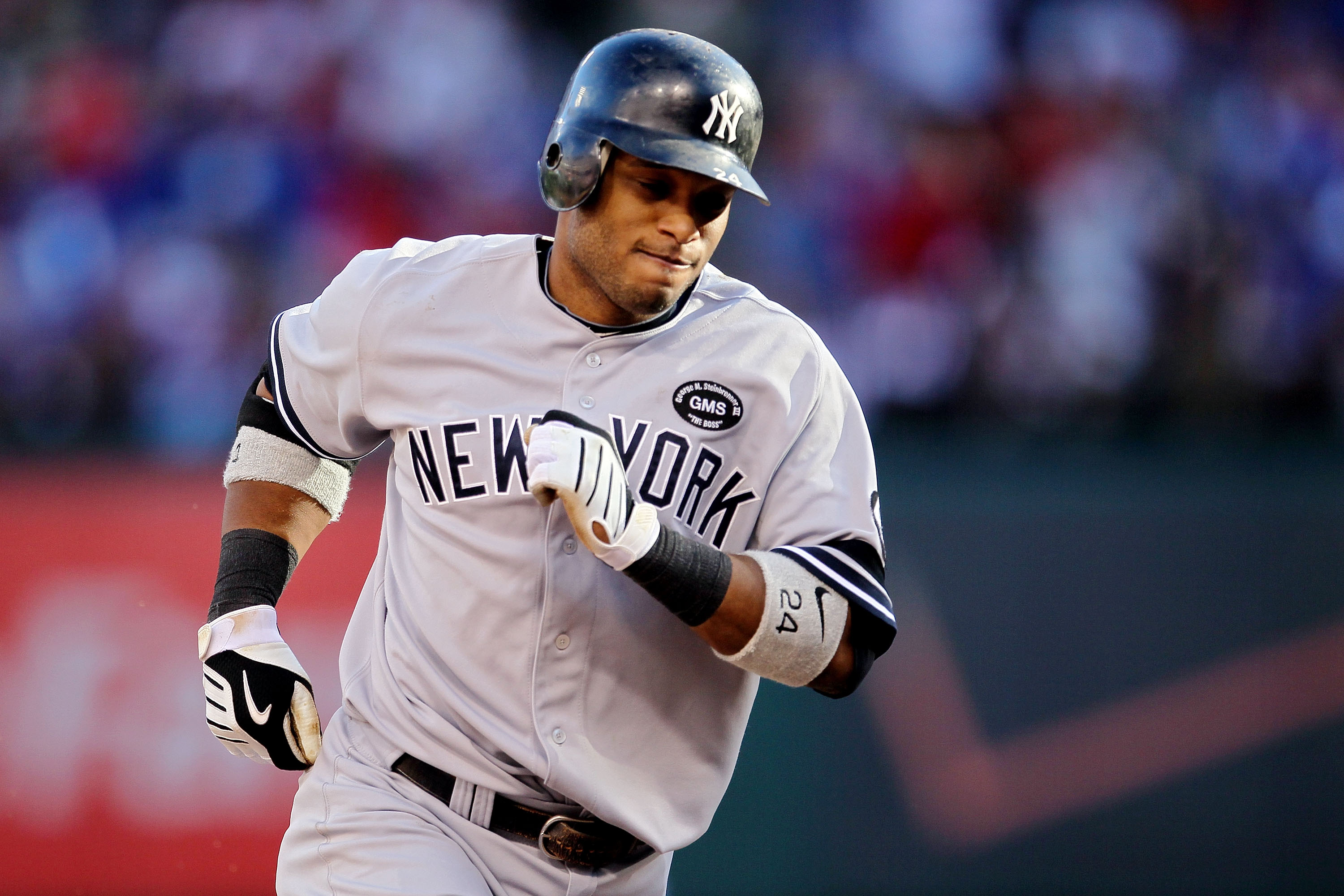 ARLINGTON, TX - OCTOBER 16:  Robinson Cano #24 of the New York Yankees rounds the bases after hitting a solo homerun in the sixth inning against the Texas Rangers in Game Two of the ALCS during the 2010 MLB Playoffs at Rangers Ballpark in Arlington on Oct