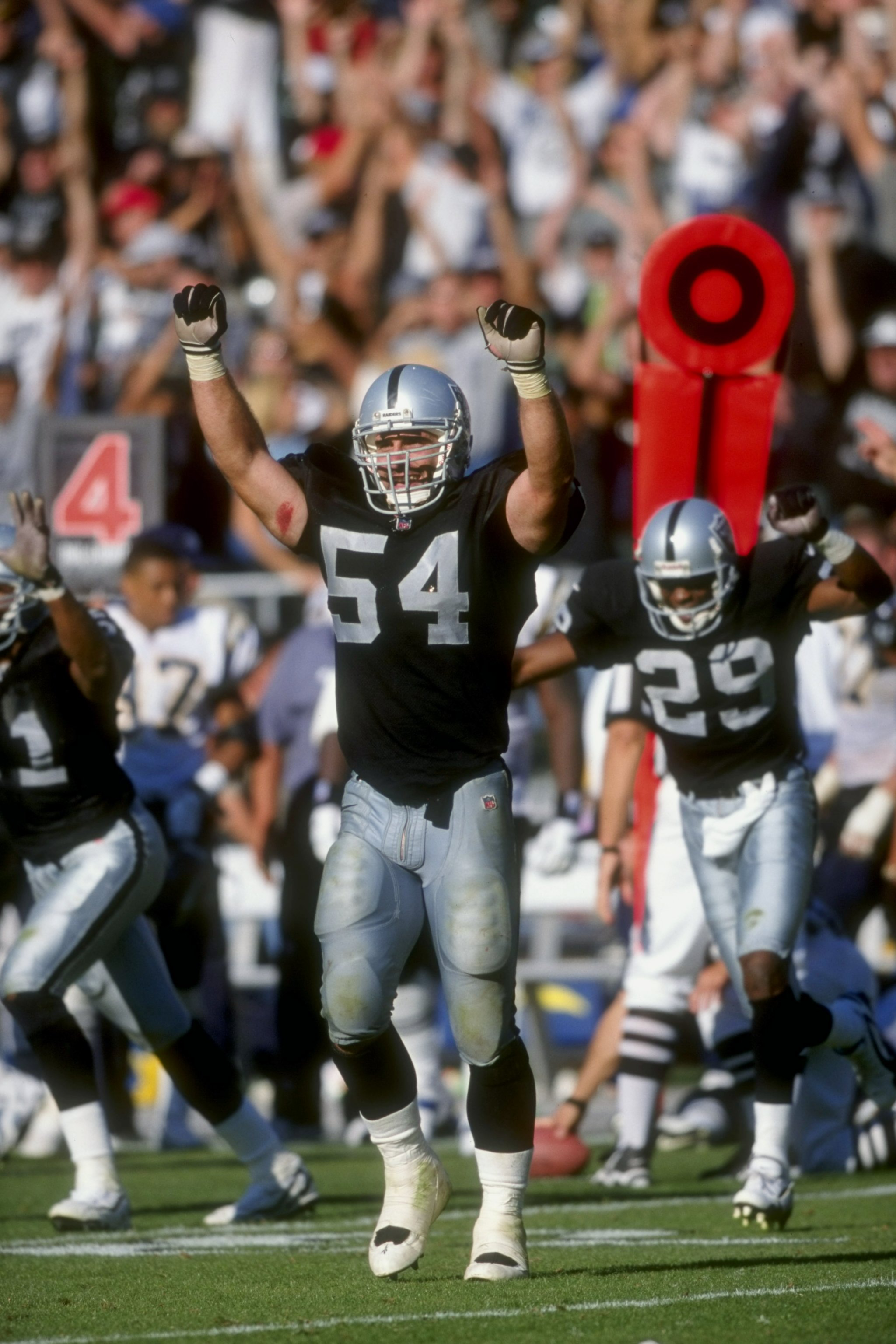 11 Oct 1998:  Greg Biekert #54 of the Oakland Raiders celebrates on the field during the game against the San Diego Chargers at Oakland Coliseum in Oakland, California.The Raiders defeated the Chargers 7-6. Mandatory Credit: David Taylor  /Allsport