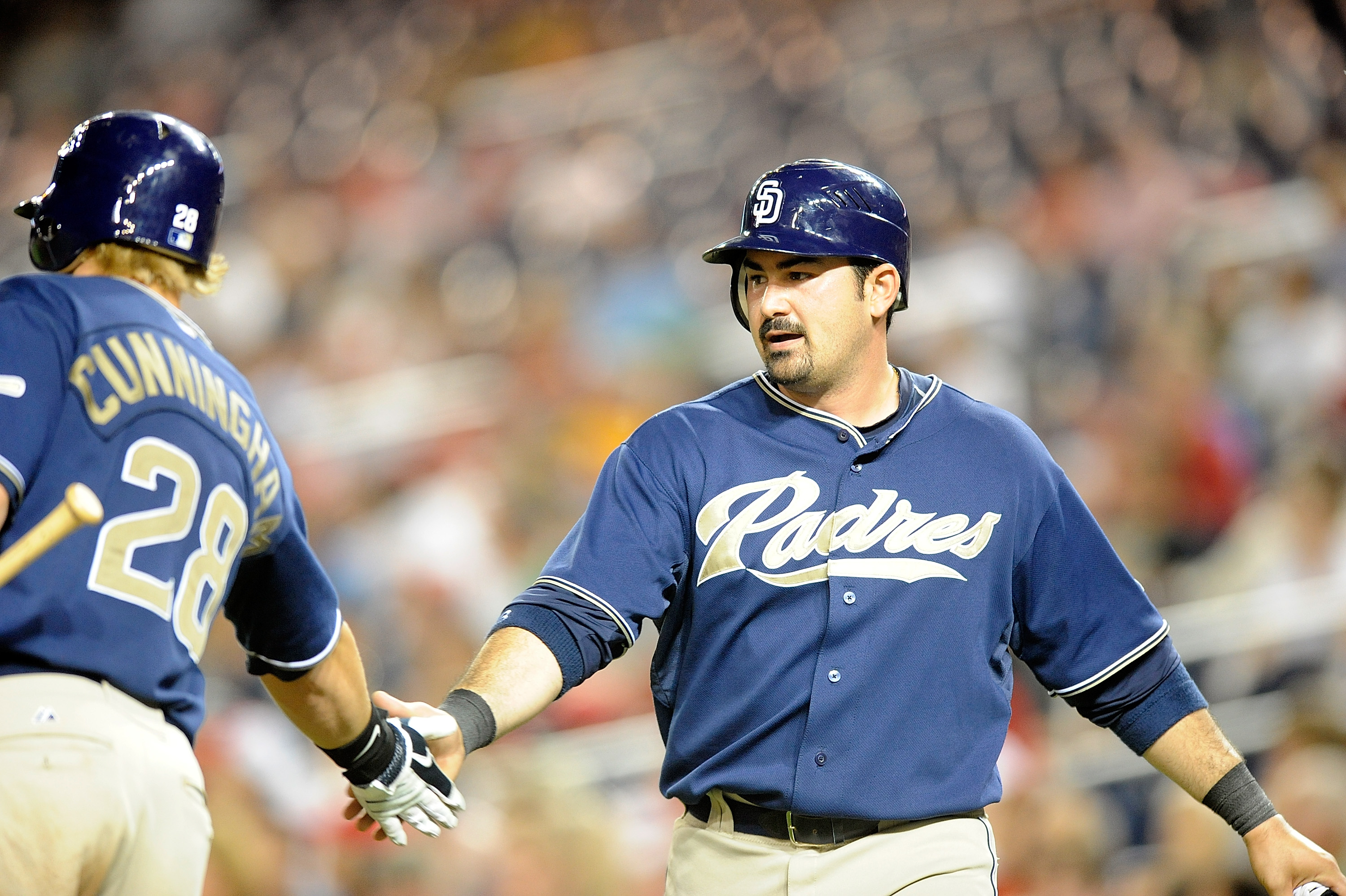 WASHINGTON - JULY 06:  Adrian Gonzalez #23 of the San Diego Padres is congratulated by Aaron Cunningham #28 after scoring in the eighth inning against the Washington Nationals at Nationals Park on July 6, 2010 in Washington, DC.  (Photo by Greg Fiume/Gett