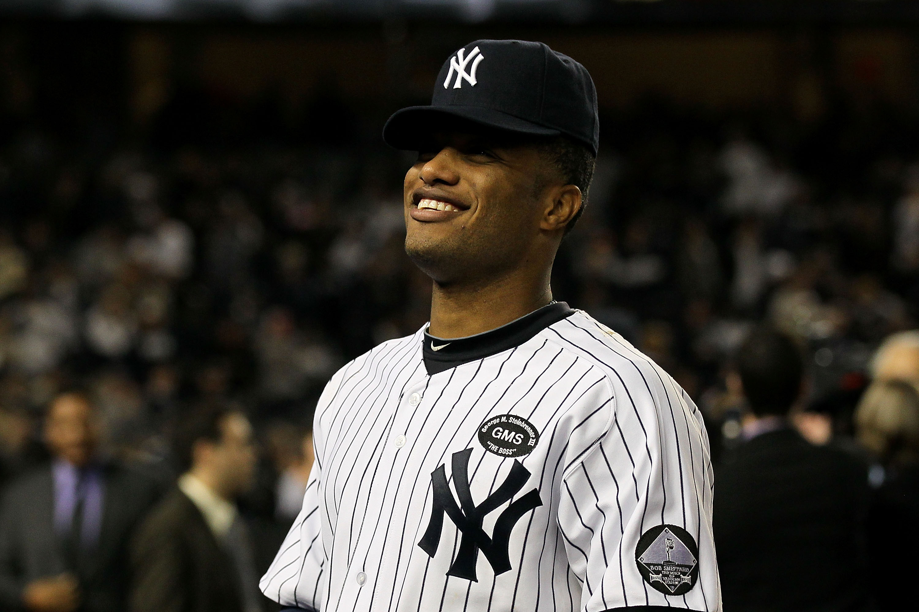 NEW YORK - OCTOBER 09:  Robinson Cano #24 of the New York Yankees celebrates afte the Yankees 6-1 win against the Minnesota Twins during Game Three of the ALDS part of the 2010 MLB Playoffs at Yankee Stadium on October 9, 2010 in the Bronx borough of New