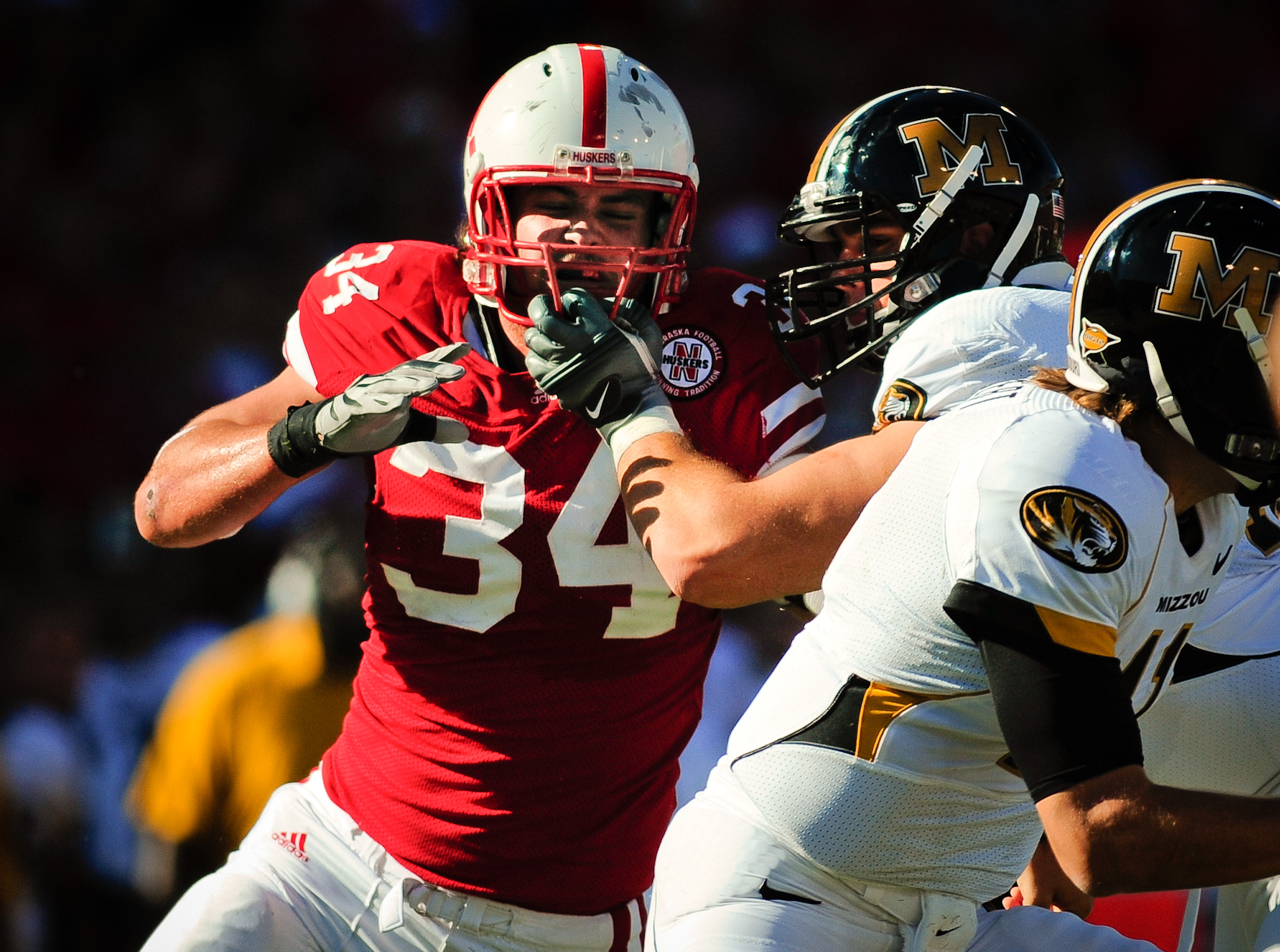 LINCOLN, NE - OCTOBER 30: Defensive end Cameron Meredith #34 of the Nebraska Cornhuskers  tries to beat offensive linesman Elvis Fisher #72 of the Missouri Tigers during first half action of their game at Memorial Stadium on October 30, 2010 in Lincoln, N
