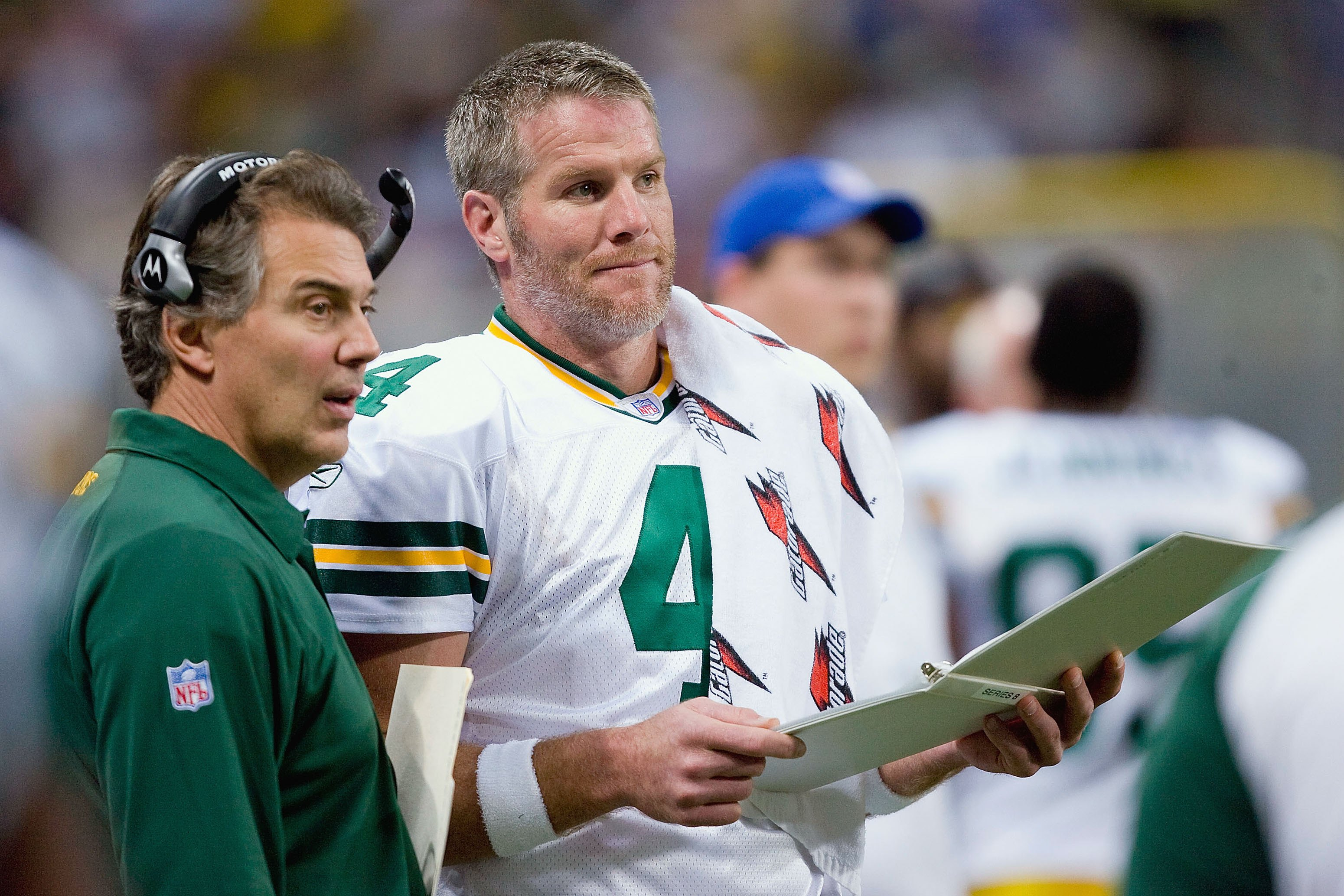 ST. LOUIS, MO - DECEMBER 16: Brett Favre #4 and Quarterback Coach Tom Clements of the Green Bay Packers look throught the playbook during the game against the St. Louis Rams on December 16, 2007 at the Edward Jones Dome in St. Louis, Missouri.  The Packer