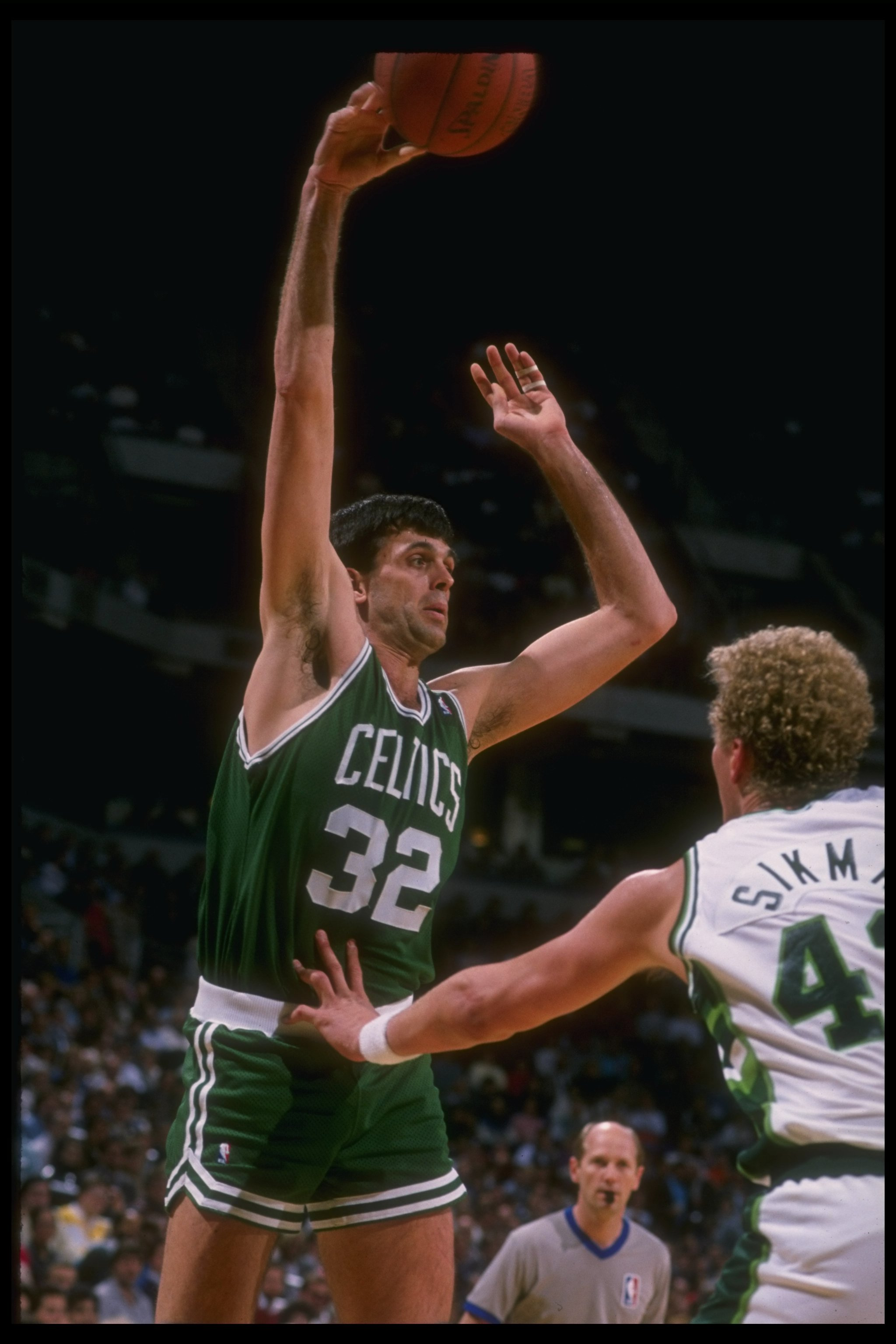 Forward Kevin McHale of the Boston Celtics shoots the ball during a game versus the Milwaukee Bucks at the Bradley Center in Milwaukee, Wisconsin.